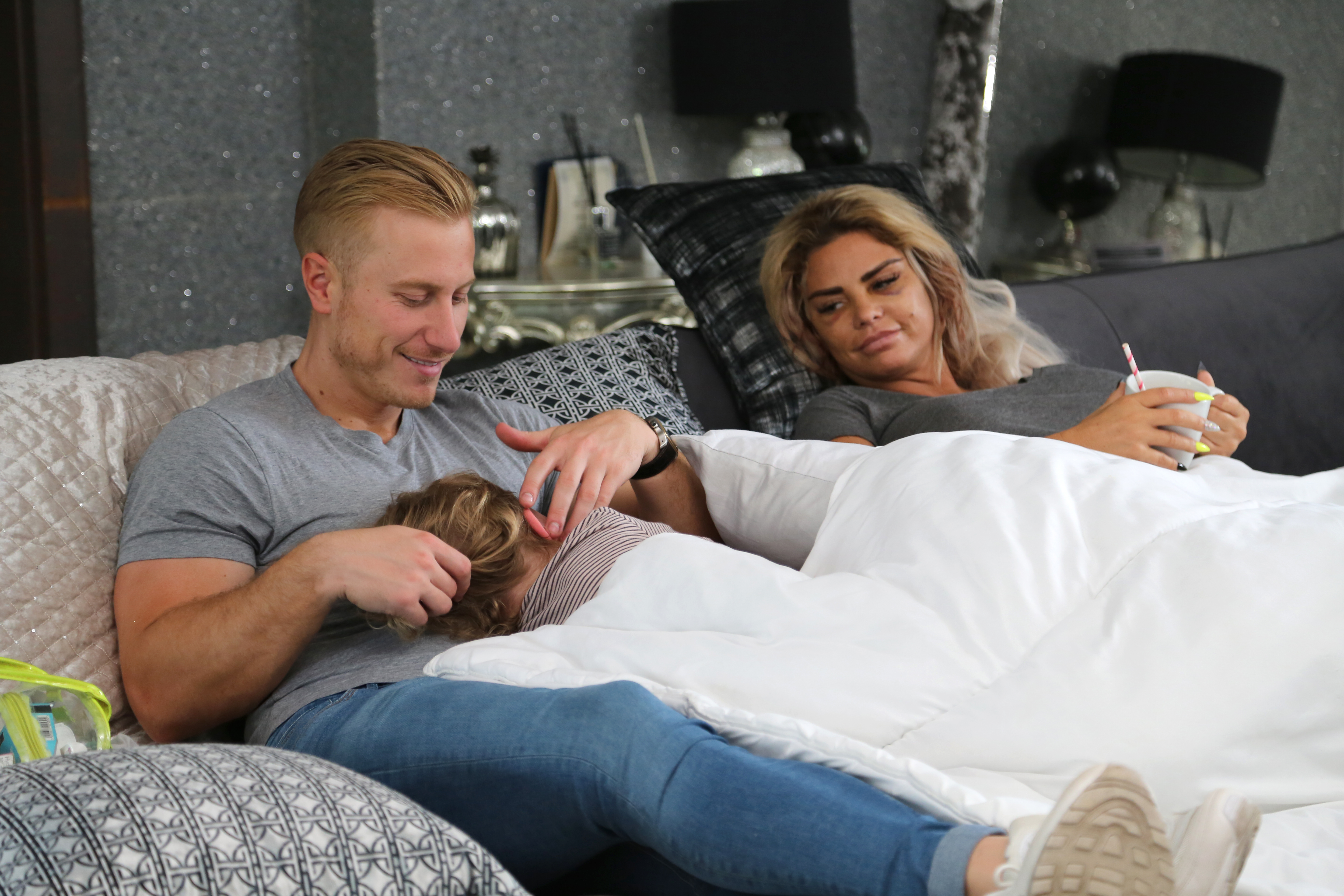 Katie Price is looked after by boyfriend Kris as she recovers from surgery (Credit: Quest Red)
