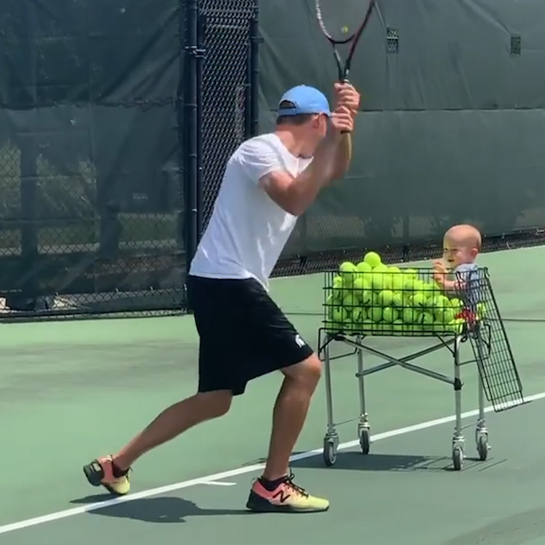 Adorable Baby Helps His Dad Play Tennis Video
