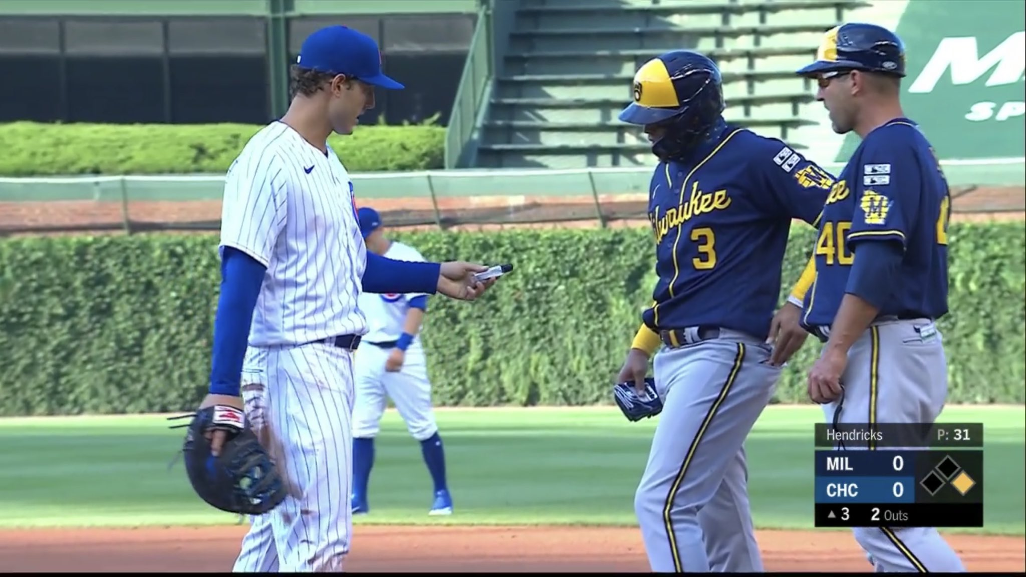Video: Cubs 1B Anthony Rizzo gives Orlando Arcia hand sanitizer