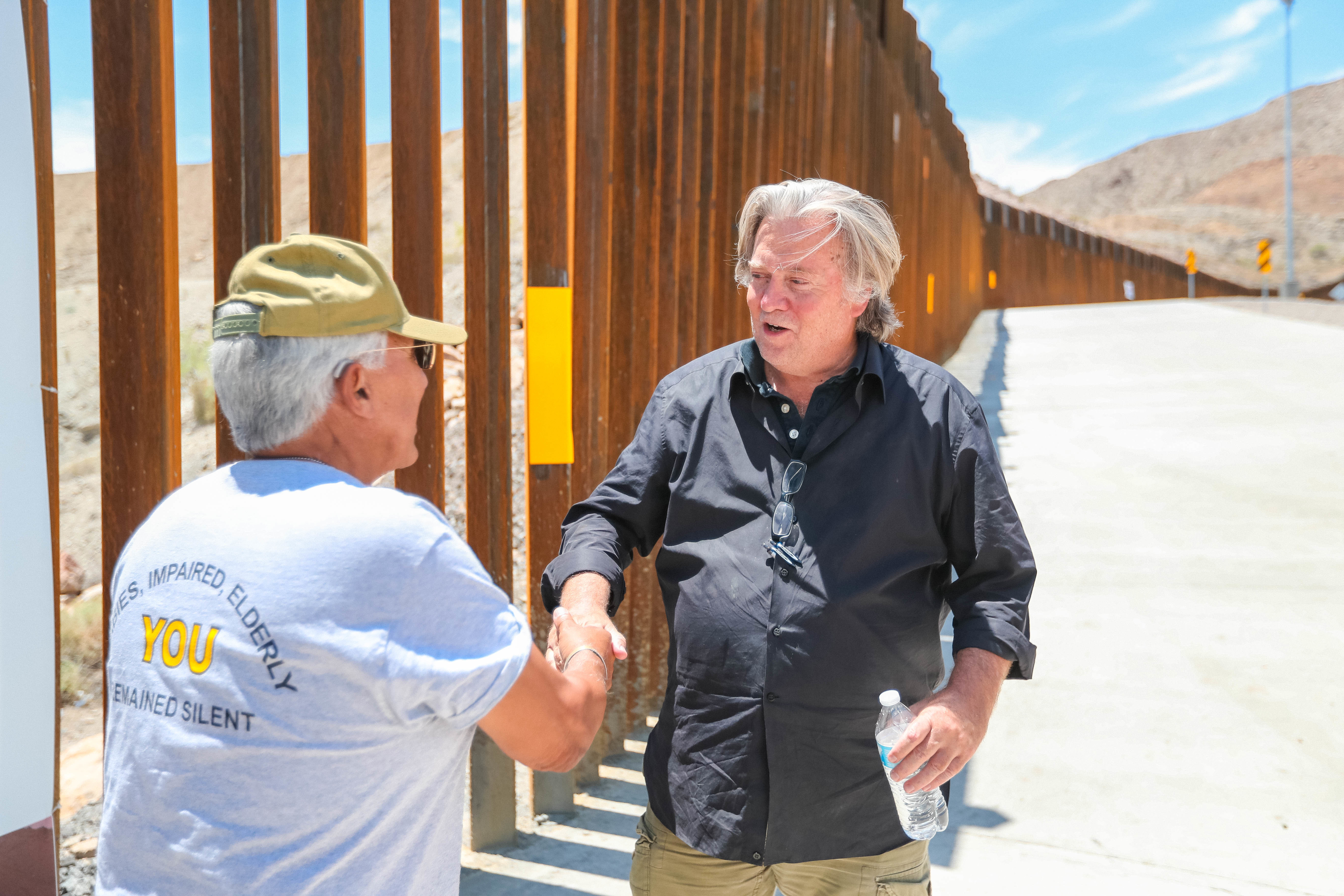 Steve Bannon vistis with a fan at the Symposium at the Wall: Cartels, Trafficking and Asylum near a privately built border wall in Sunland Park, New Mexico, constructed by the WeBuildTheWall organization on American Eagle Brick Co. property on Saturday, July 27, 2019. (Photo by Nathan J Fish/Sun-News via Imagn Content Services, LLC/USA Today Network/Sipa USA)