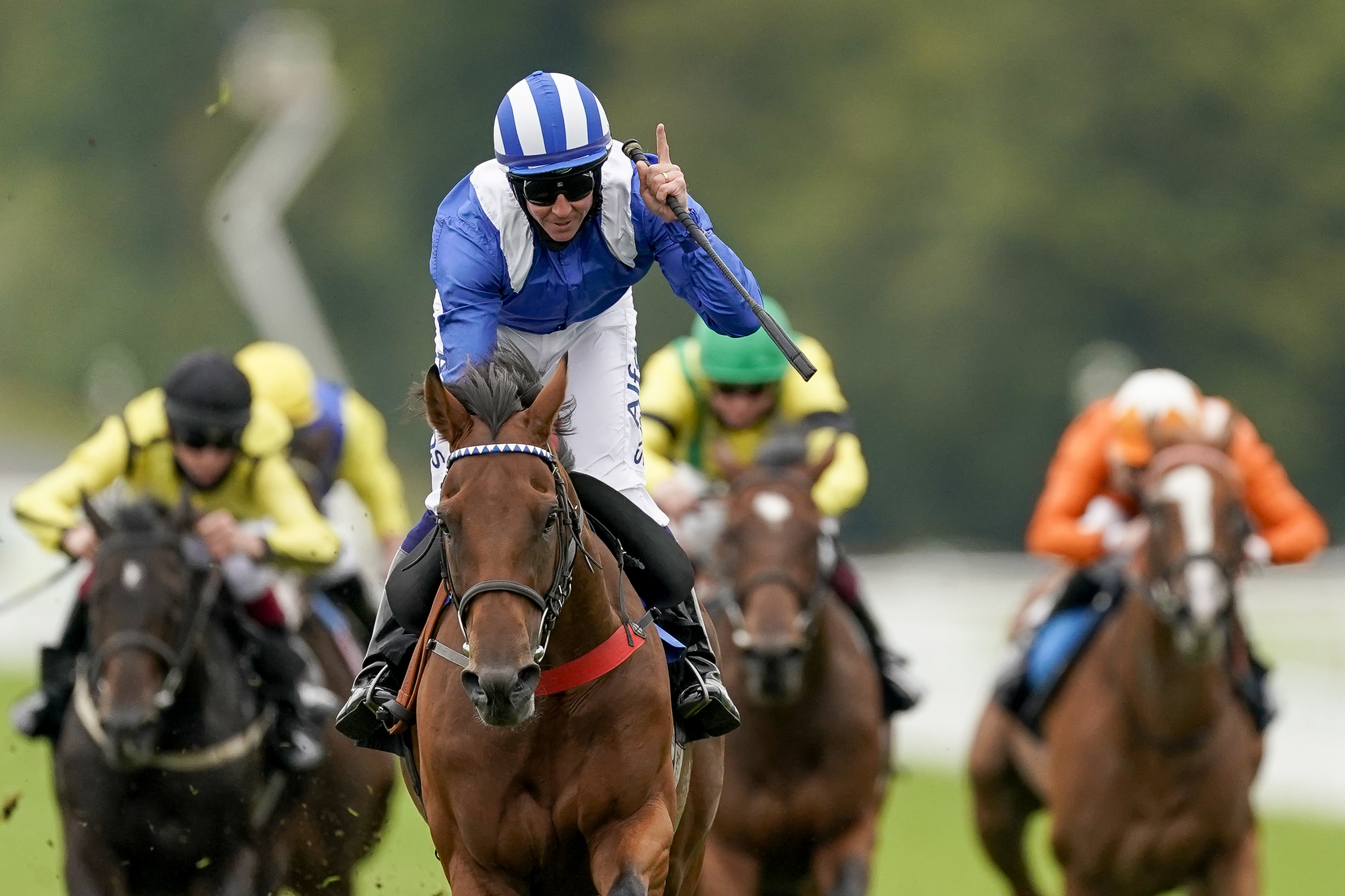 Jim Crowley on board Modmin on their way to winning the The Ladbrokes Supporting 'Children With Cancer UK' Novice Stakes at Goodwood Racecourse, Chichester. Jim Crowley celebrates his two thousandth UK victory in National Hunt and Flat racing