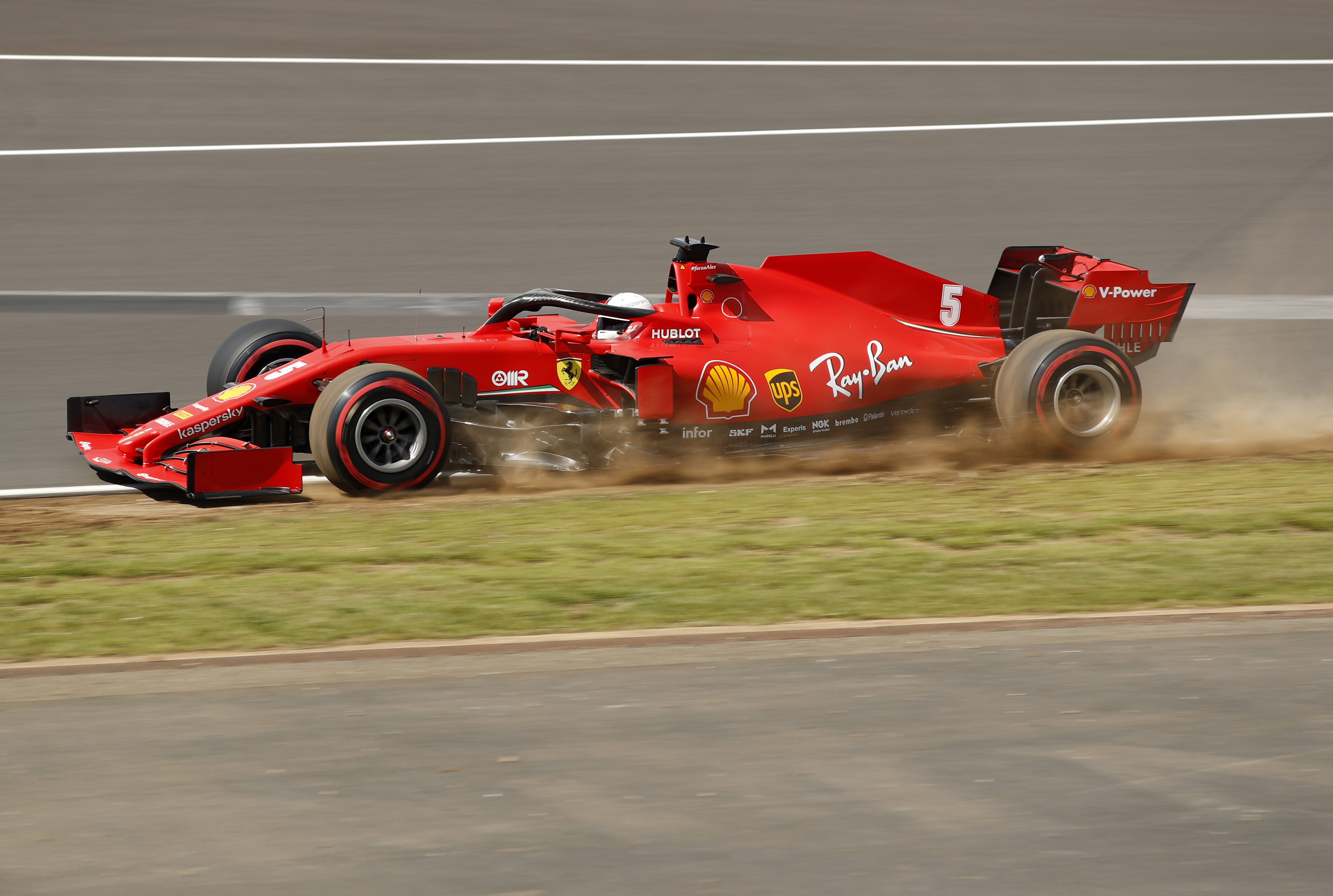 Ferrari driver Sebastian Vettel of Germany steers his car during the qualifying session session for the British Formula One Grand Prix at the Silverstone racetrack, Silverstone, England, Saturday, Aug. 1, 2020. The British Formula One Grand Prix will be held on Sunday. (Andrew Boyers/Poolvia AP)