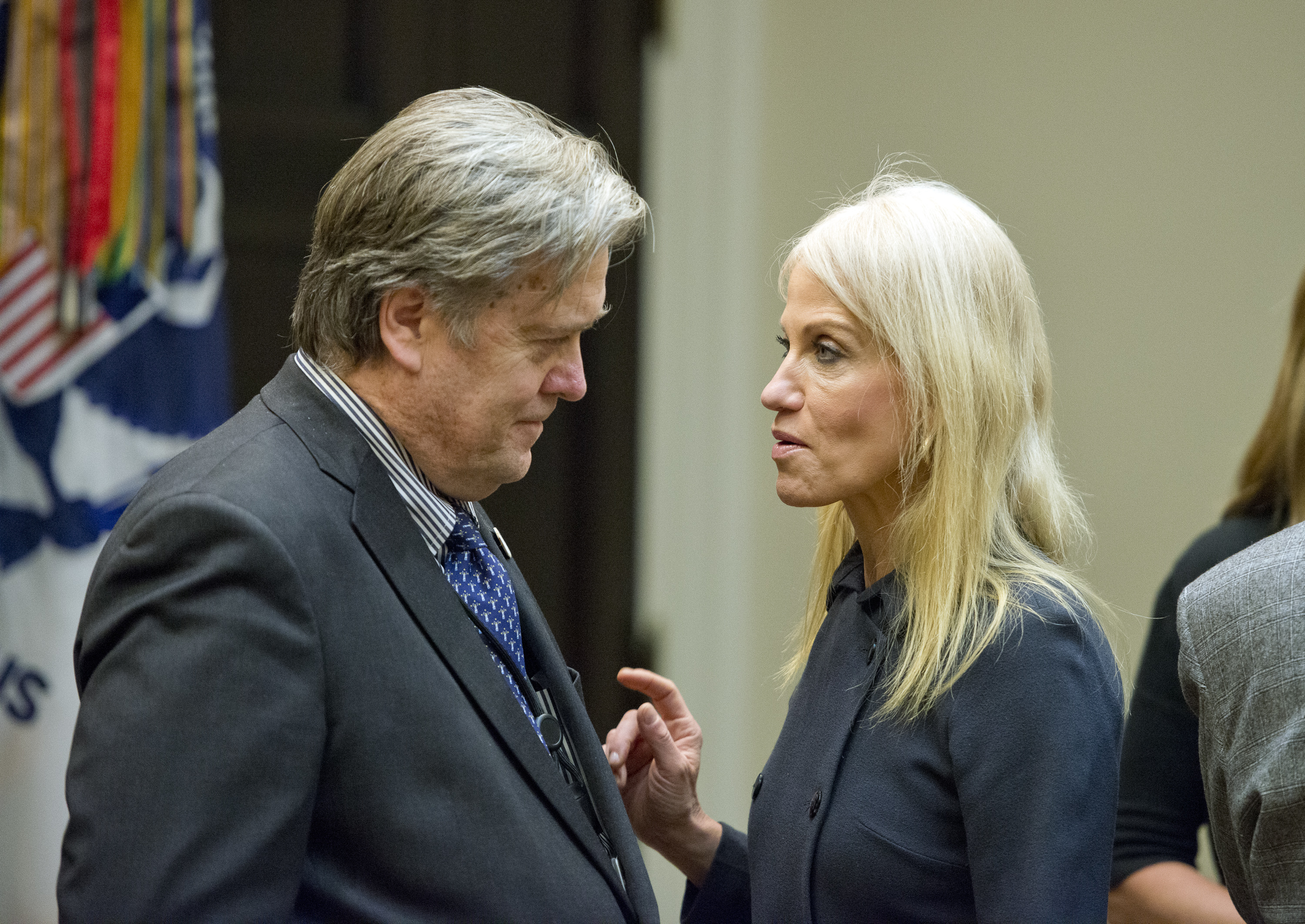 Assistant to the President and Chief Strategist Steve Bannon, left and Counselor to the President Kellyanne Conway, right, have a conversation prior to the arrival of US President Donald Trump who will hold a listening session with cyber security experts in the in the Roosevelt Room of the White House in Washington, DC on Tuesday, January 31, 2017. Credit: Ron Sachs / Pool via CNP *** Please Use Credit from Credit Field ***