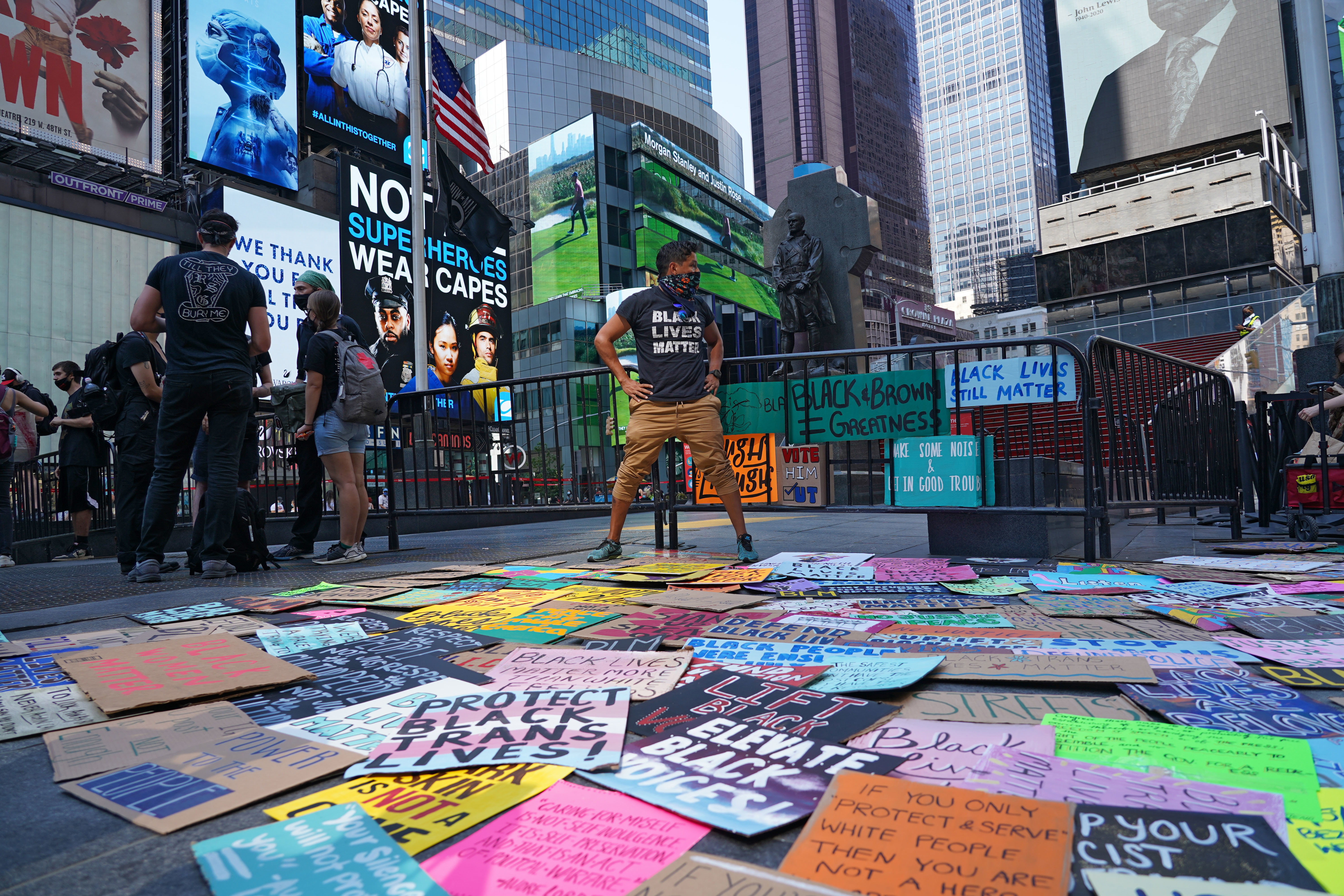 A protester selects a placard at Times Square during the Black lives matter protest. Protesters took to the streets to demand the arrest of an officer responsible for the death of Breonna Taylor on March 13, 2020 in Louisville, Kentucky. (Photo by Ron Adar / SOPA Images/Sipa USA)