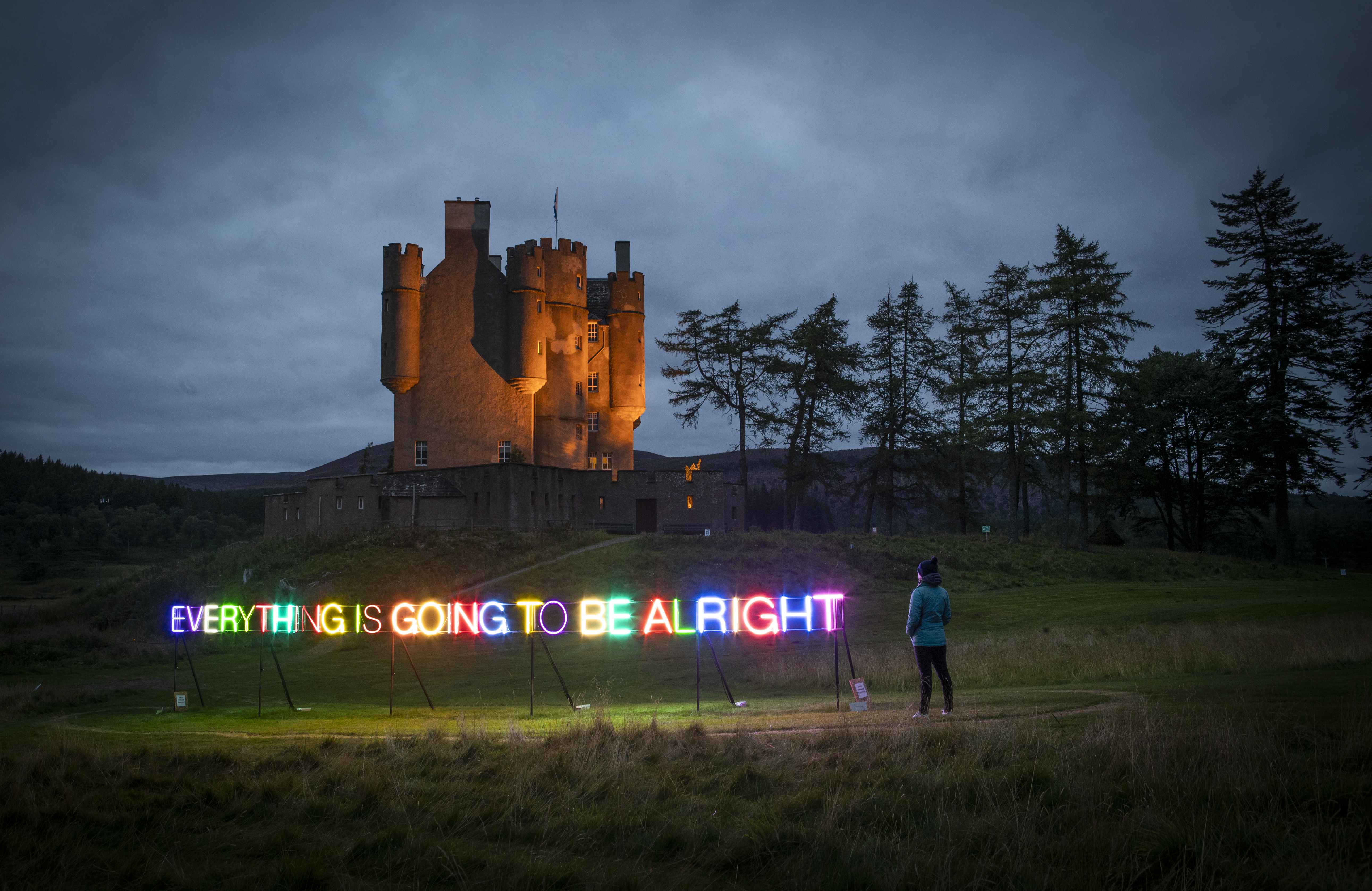 """A multi-coloured neon sign that reads """"Everything Is Going To Be Alright"""" by Turner Prize winning artist Martin Creed has been unveiled in the grounds of Braemar Castle, Aberdeenshire. (Photo by Jane Barlow/PA Images via Getty Images)"""