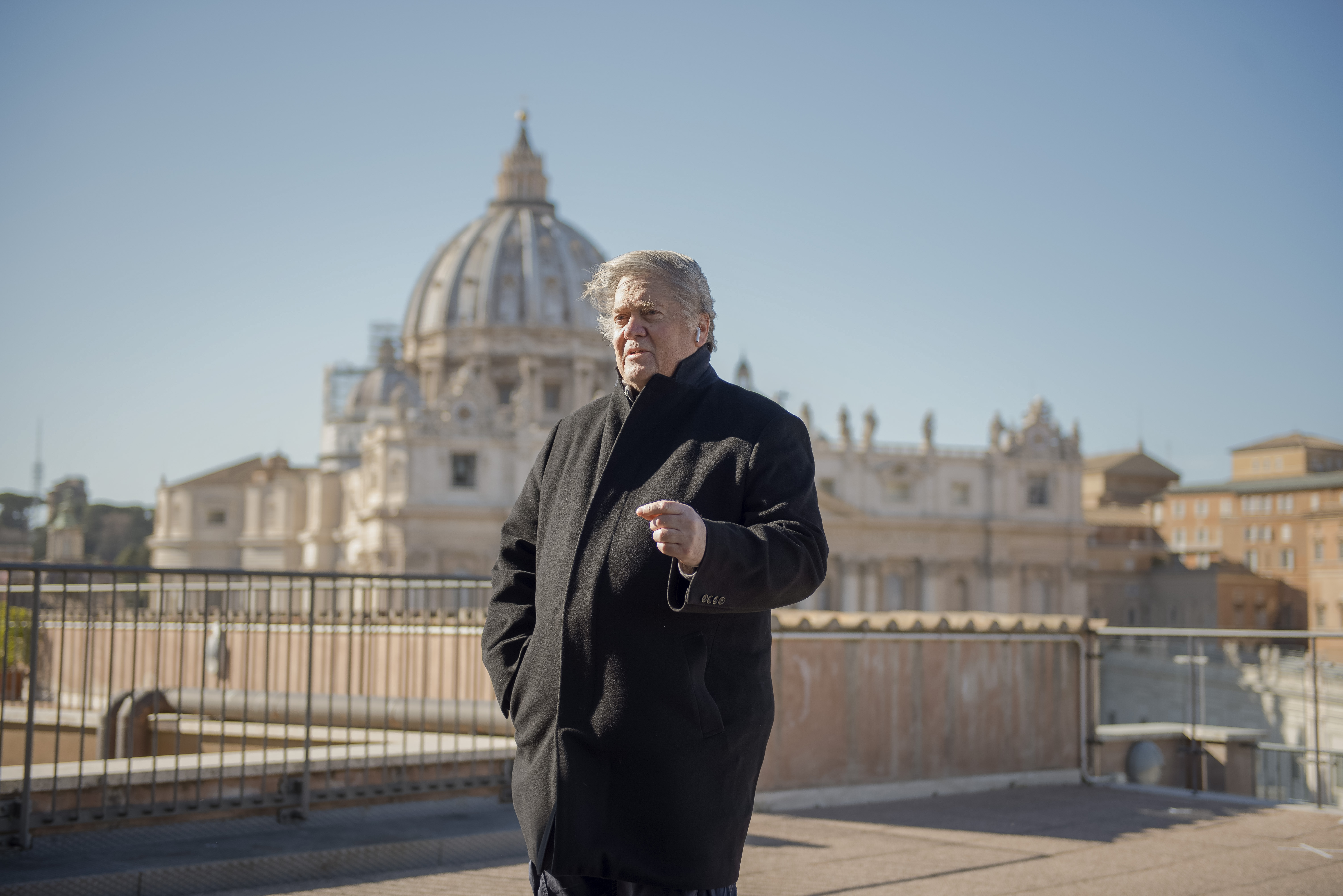 In this picture taken Saturday, Feb. 23, 2019, former White House strategist Steve Bannon poses for portraits during a break of his media activities on a terrace overlooking St. Peter's Square at the Vatican. (AP Photo/Marco Bonomo)