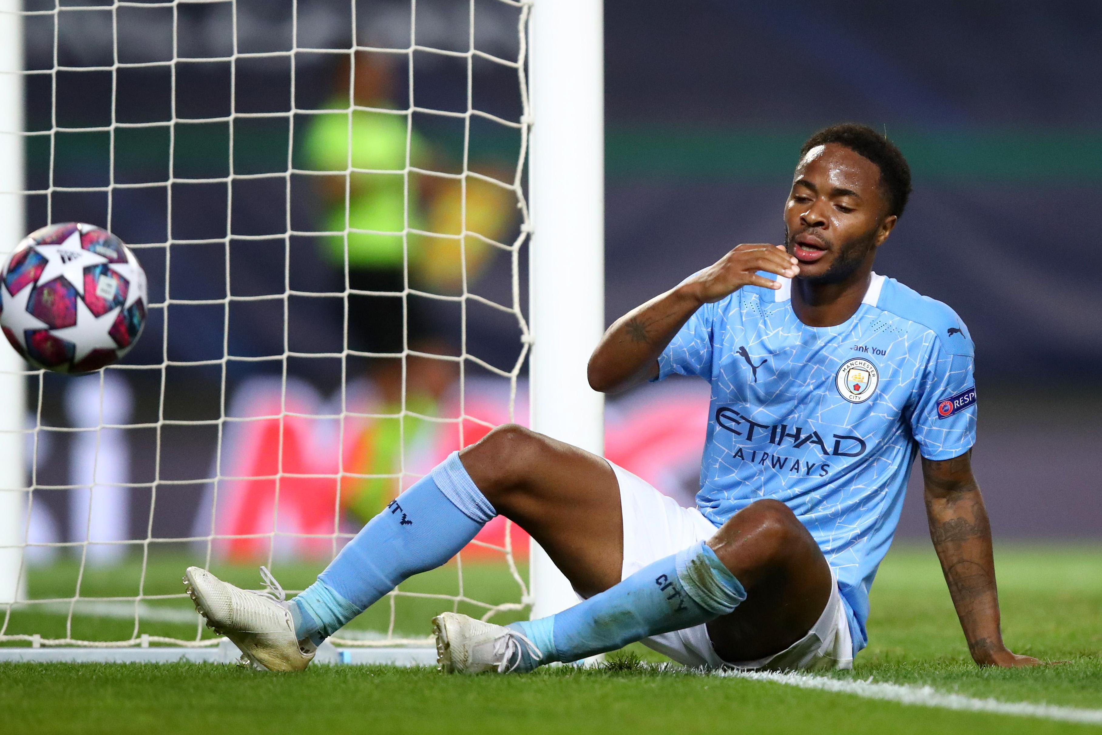 LISBON, PORTUGAL - AUGUST 15: Raheem Sterling of Manchester City looks dejected after a missed chance during the UEFA Champions League Quarter Final match between Manchester City and Lyon at Estadio Jose Alvalade on August 15, 2020 in Lisbon, Portugal. (Photo by Julian Finney - UEFA/UEFA via Getty Images)