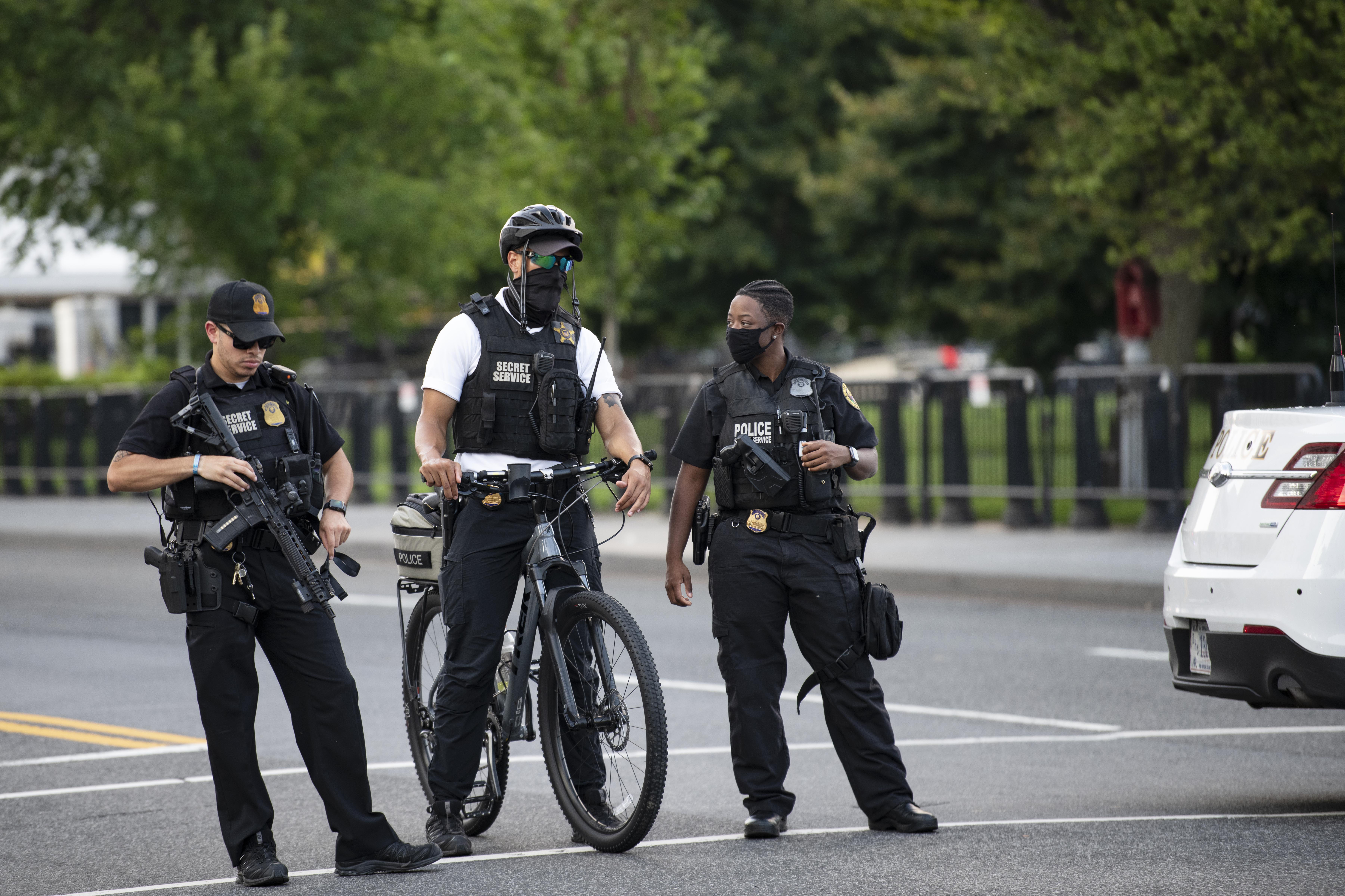 WASHINGTON, D.C., Aug. 10, 2020 -- U.S. Secret Service staff respond to a shooting near the White House in Washington, D.C., the United States, Aug. 10, 2020. U.S. President Donald Trump on Monday afternoon was temporarily escorted by the Secret Service away from an ongoing coronavirus briefing after a shooting was reported outside the White House.(Photo by Liu Jie/Xinhua via Getty) (Xinhua/Liu Jie via Getty Images)