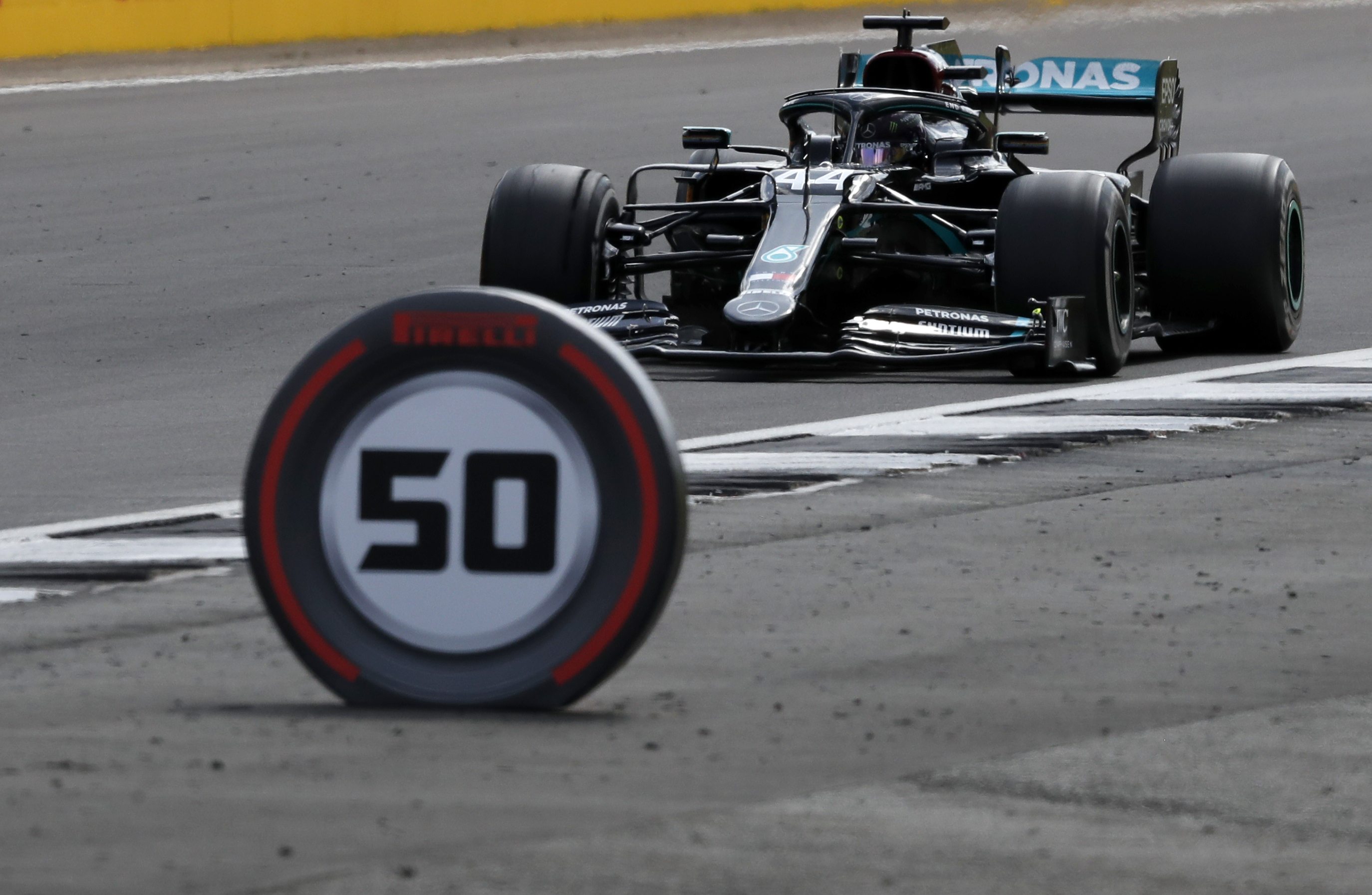 Mercedes driver Lewis Hamilton of Britain steers his car during the British Formula One Grand Prix at the Silverstone racetrack, Silverstone, England, Sunday, Aug. 2, 2020. (AP Photo/Frank Augstein,Pool)
