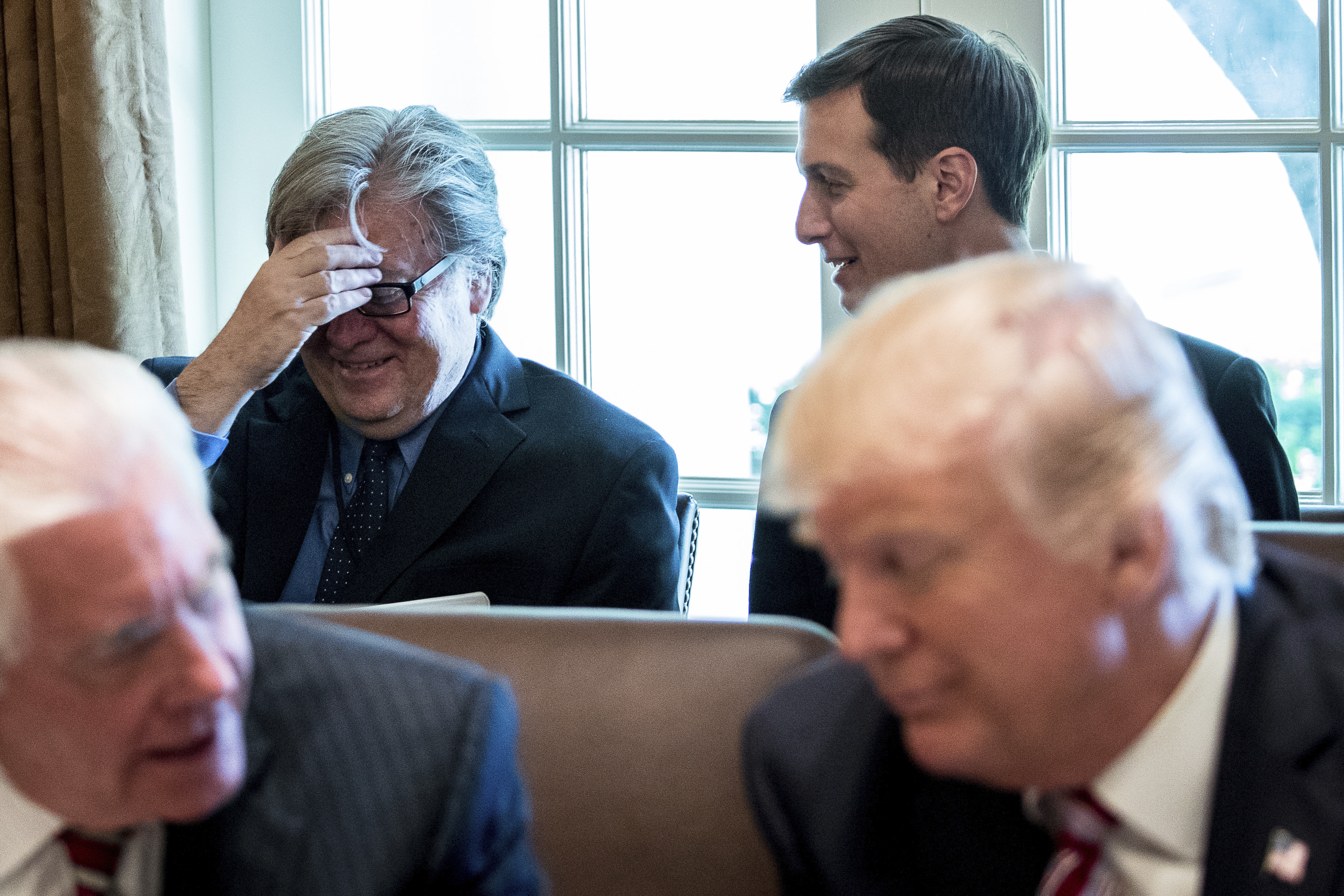 White House Senior Advisers Steve Bannon and Jared Kushner talk behind President Donald Trump and Secretary of State Rex Tillerson during a Cabinet meeting, Monday, June 12, 2017, in the Cabinet Room of the White House in Washington. (AP Photo/Andrew Harnik)