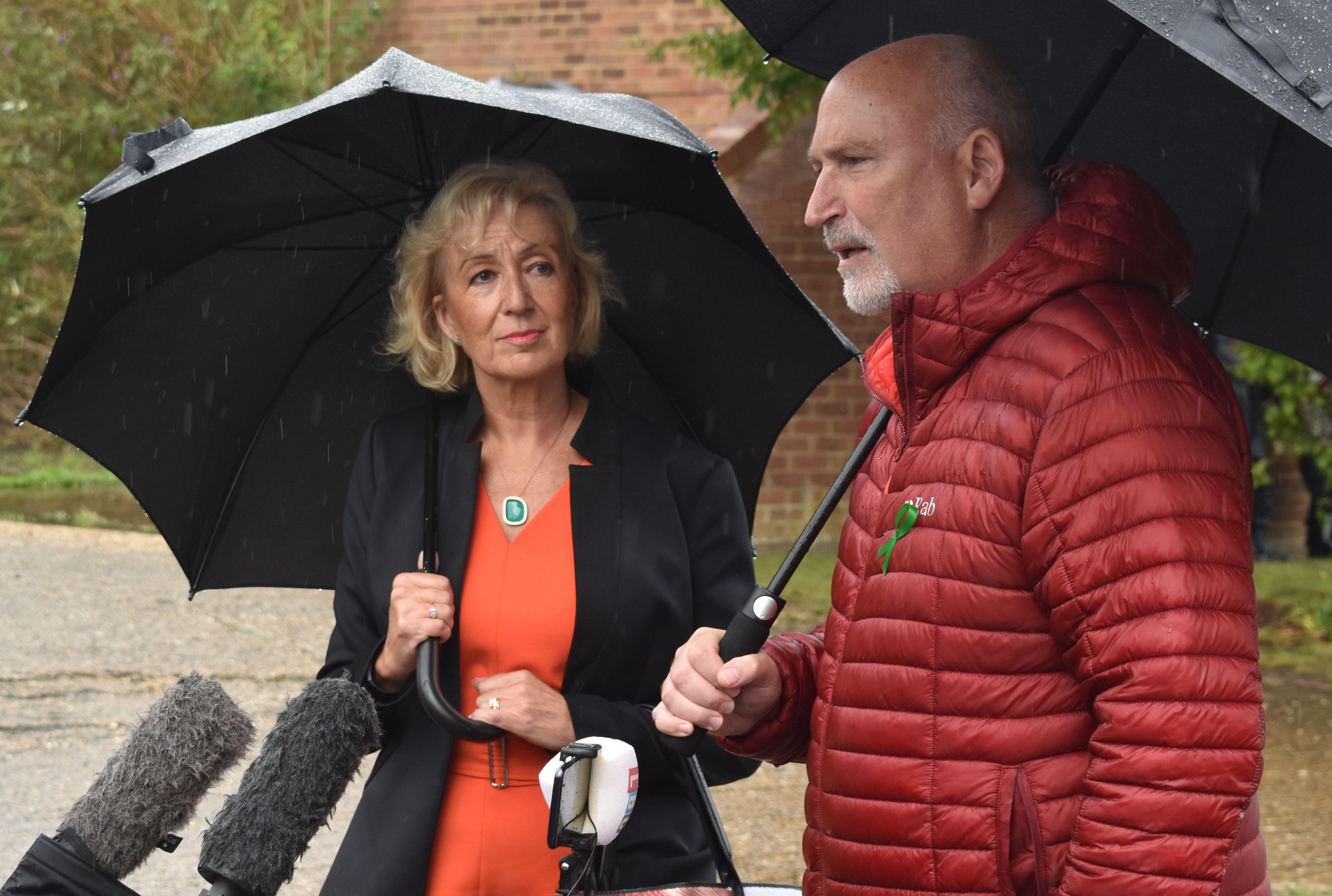Andrea Leadsom MP and Harry Dunn family spokesman Radd Seiger arrive to speak to the media in Brackley, Northamptonshire, where the MP called on Donald Trump to personally intervene to ensure suspect Anne Sacoolas faces trial over teenager Harry Dunn's death a year ago.