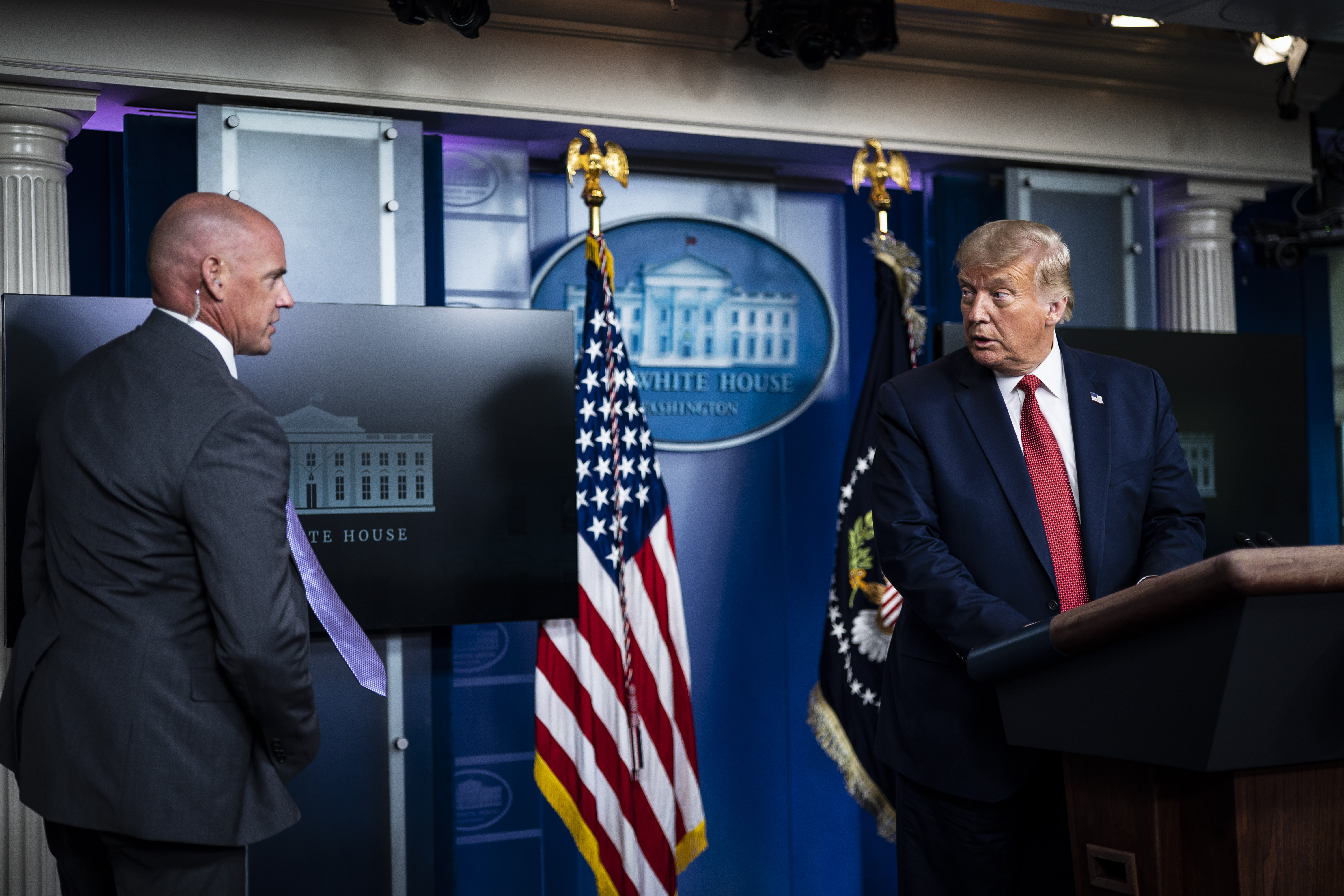 WASHINGTON, DC - AUGUST 10: A member of the United States Secret Service asks President Donald J. Trump to follow him as he speaks moment after a shooting outside the White House during a COVID-19 coronavirus briefing in the James S. Brady Briefing Room at the White House at the White House on Monday, Aug 10, 2020 in Washington, DC. (Photo by Jabin Botsford/The Washington Post via Getty Images)