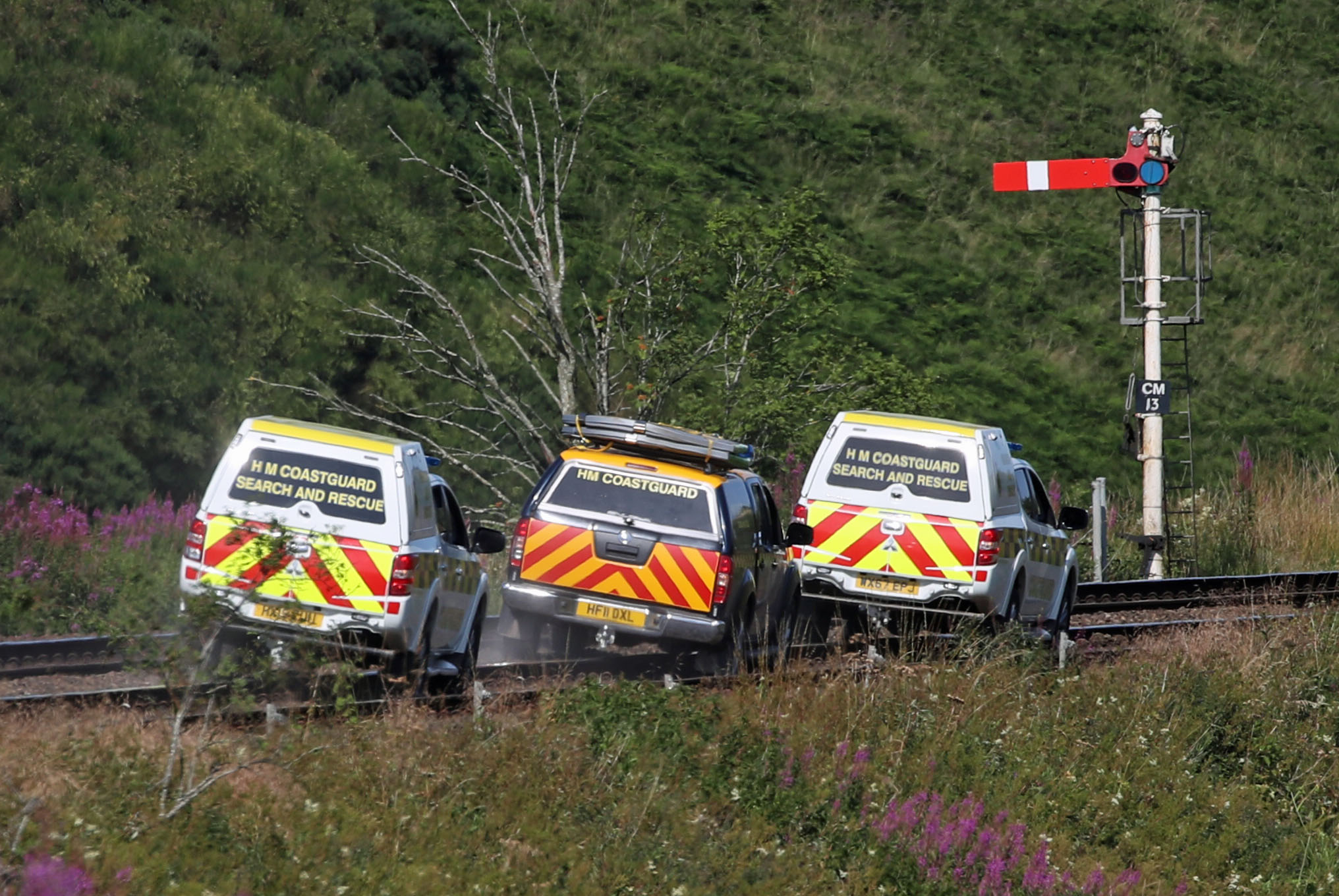 HM Coastguard vehicles at Carmont crossing, where they are accessing the train line from the road, south of the scene in Stonehaven, Aberdeenshire, where the 06.38 Aberdeen to Stonehaven ScotRail train derailed at about 9.40am this morning. The fire service, police and ambulance service are in attendance and the incident is ongoing. (Photo by Jane Barlow/PA Images via Getty Images)