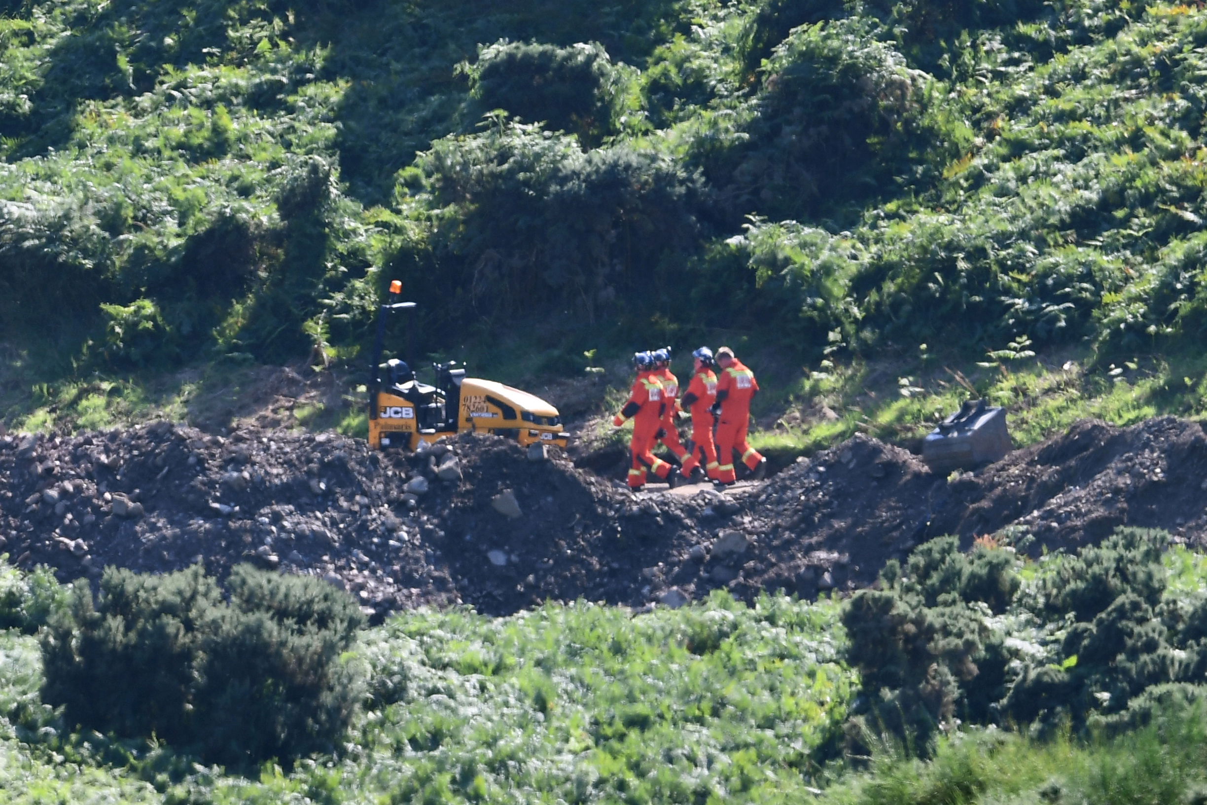 """STONEHAVEN, SCOTLAND - AUGUST 12: Emergency services attend the scene of a train derailment on August 12, 2020 in Stonehaven, Scotland.  Police Scotland said: """"A report was received of a train having derailed near Stonehaven at around 9.45am on Wednesday August 12"""" Emergency services are in attendance. (Photo by Jeff J Mitchell/Getty Images)"""