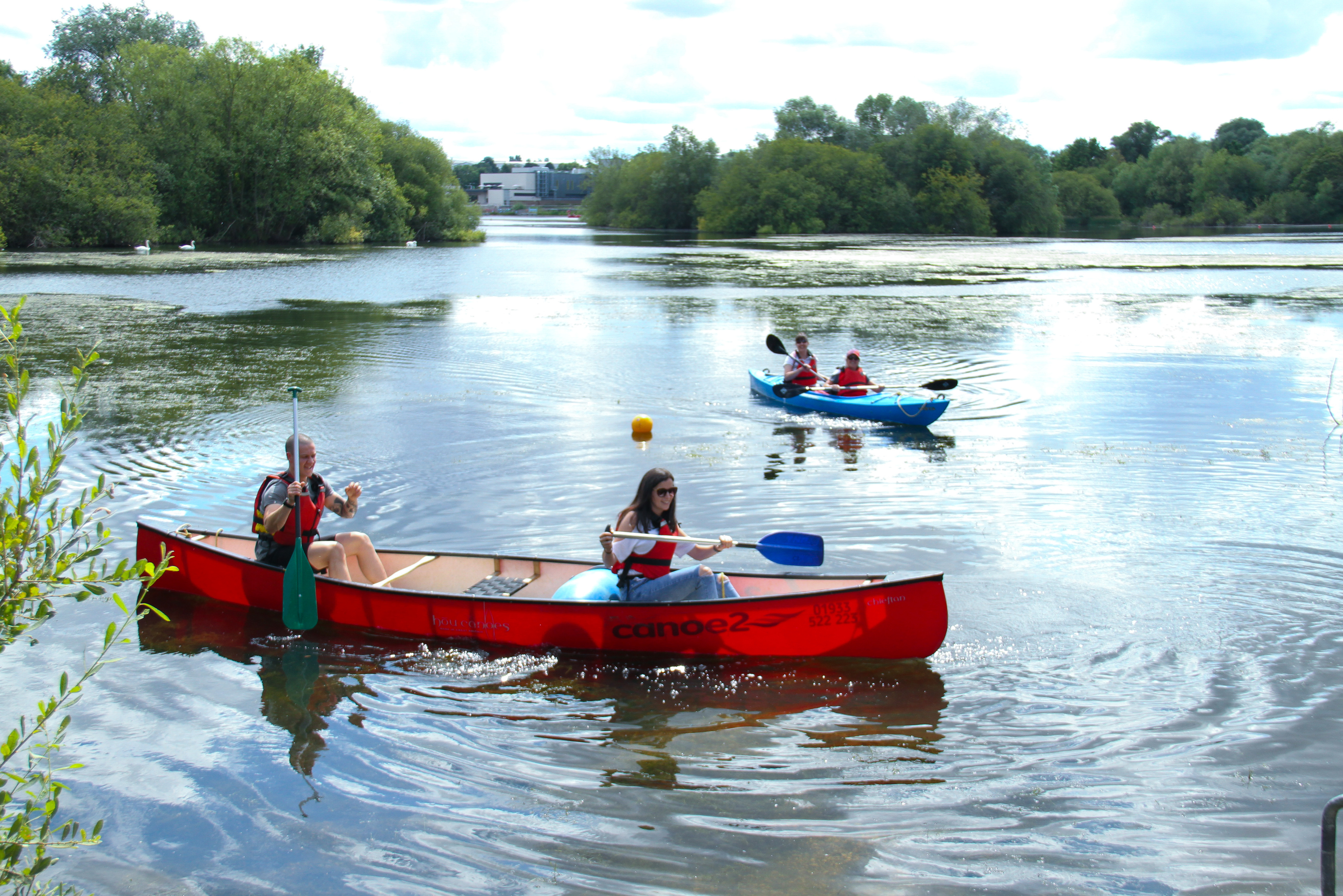 People seen rowing a canoe on the Rushden Lakes on a warm summer day. With the warm weather in the UK, people ventured outdoors amidst the novel coronavirus pandemic reprise. (Photo by David Mbiyu / SOPA Images/Sipa USA)