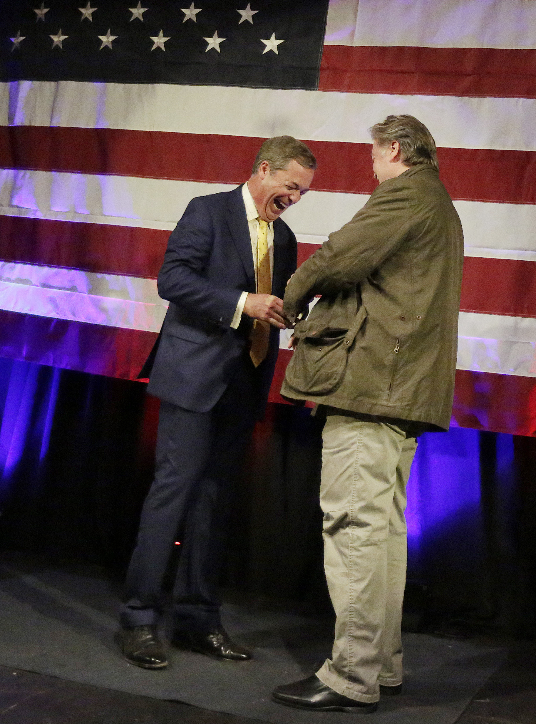 British politician Nigel Farage, left, and former White House strategist Steve Bannon, right, shown during a rally for U.S. Senate hopeful Roy Moore, Monday, Sept. 25, 2017, in Fairhope, Ala. (AP Photo/Brynn Anderson)