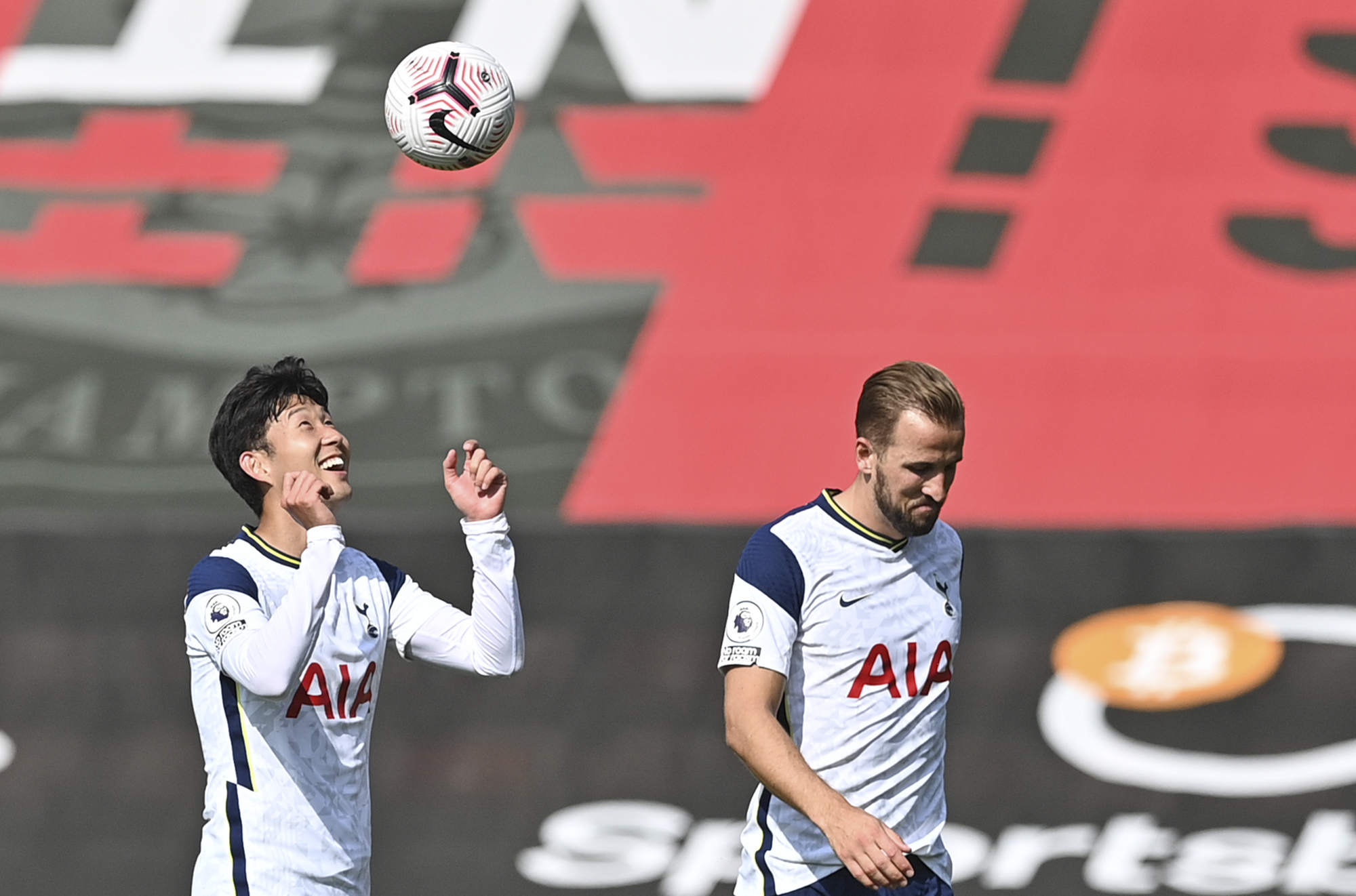 Tottenham's Son Heung-min, left, and Tottenham's Harry Kane celebrate at the end of the English Premier League soccer match between Southampton and Tottenham Hotspur at St. Mary's Stadium in Southampton, England, Sunday, Sept. 20, 2020. (Justin Tallis/Pool via AP)