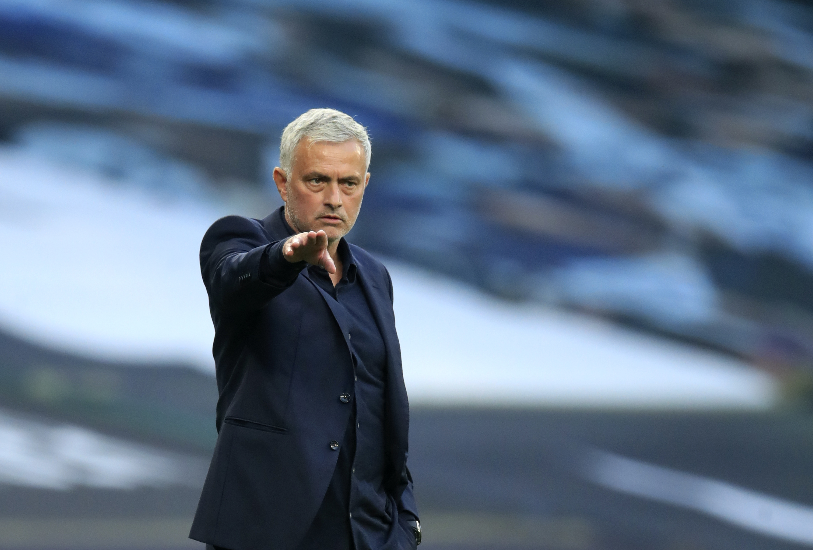 Tottenham's manager Jose Mourinho gives instructions to his players during the English Premier League soccer match between Tottenham Hotspur and Everton at the Tottenham Hotspur Stadium in London, Sunday, Sept. 13, 2020. (Adam Davy/Pool via AP)