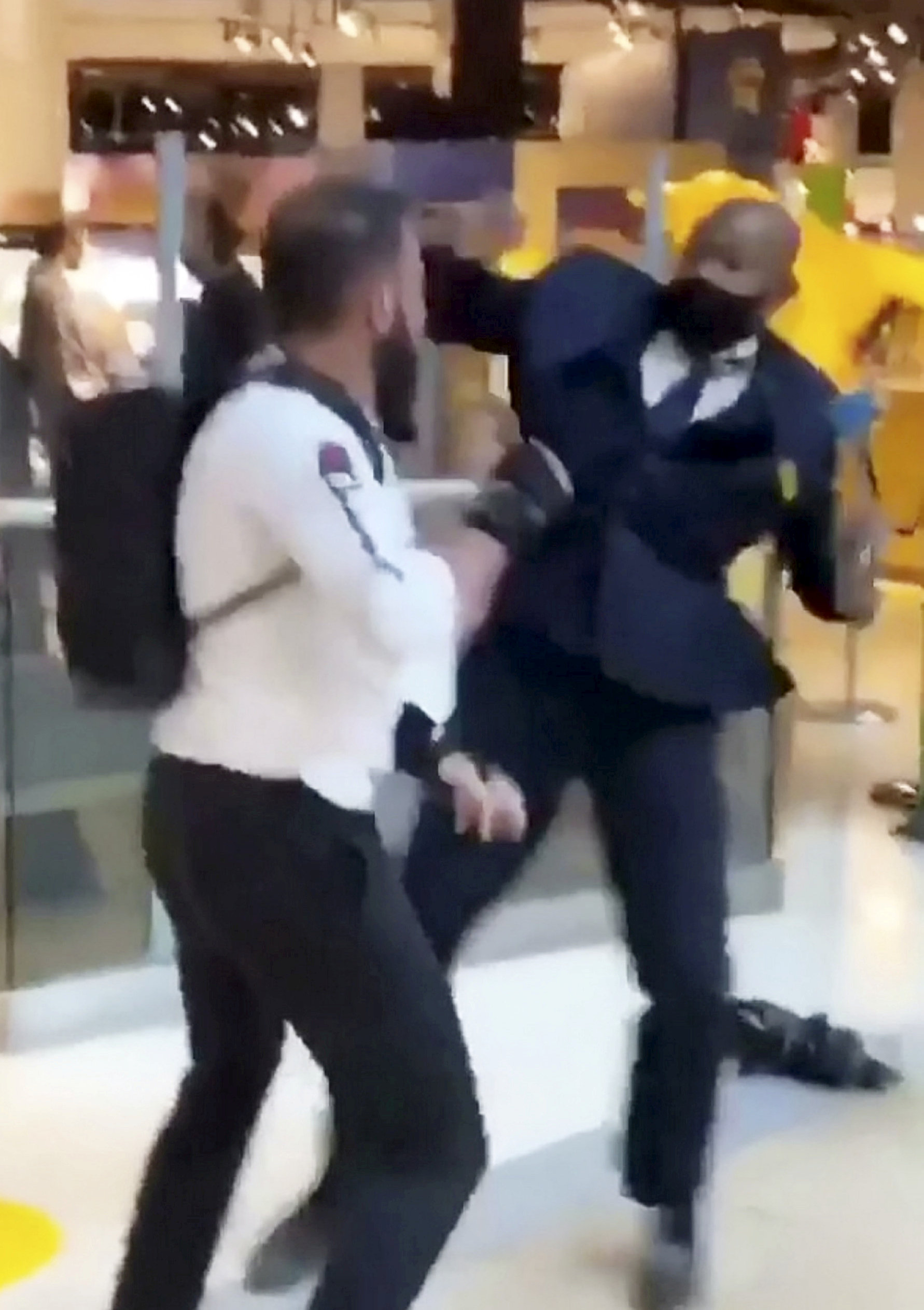 """This is the shocking moment a security guard and a shopper viciously brawled outside a Selfridges following a row about entering the store with rollerblades. The smartly-dressed security worker traded punches with the irate customer after violence erupted at Birmingham's Bull Ring shopping centre on Saturday (26/9). The pair can be seen adopting boxing stances before exchanging blows in front of stunned shoppers at the entrance of the posh department store. In the footage, obtained by website Birmz Is Grime, one man can be heard saying """"chill man"""" before the video ends with two burly men continuing to swing punches."""