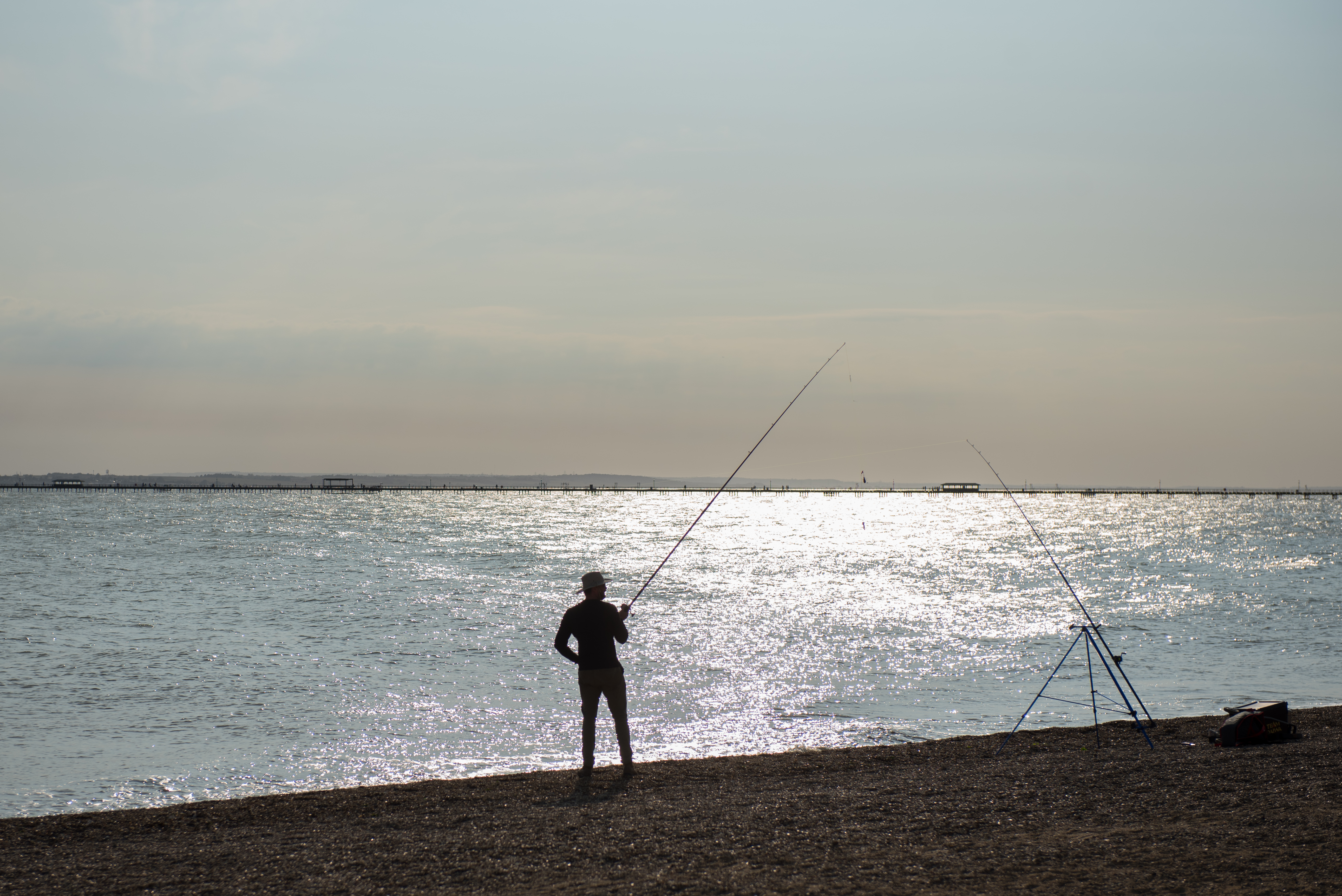 SOUTHEND-ON-SEA, ENGLAND - SEPTEMBER 20: A man fishes as the sun goes down during recent warm weather on September 20, 2020 in Southend on Sea, London. (Photo by John Keeble/Getty Images)
