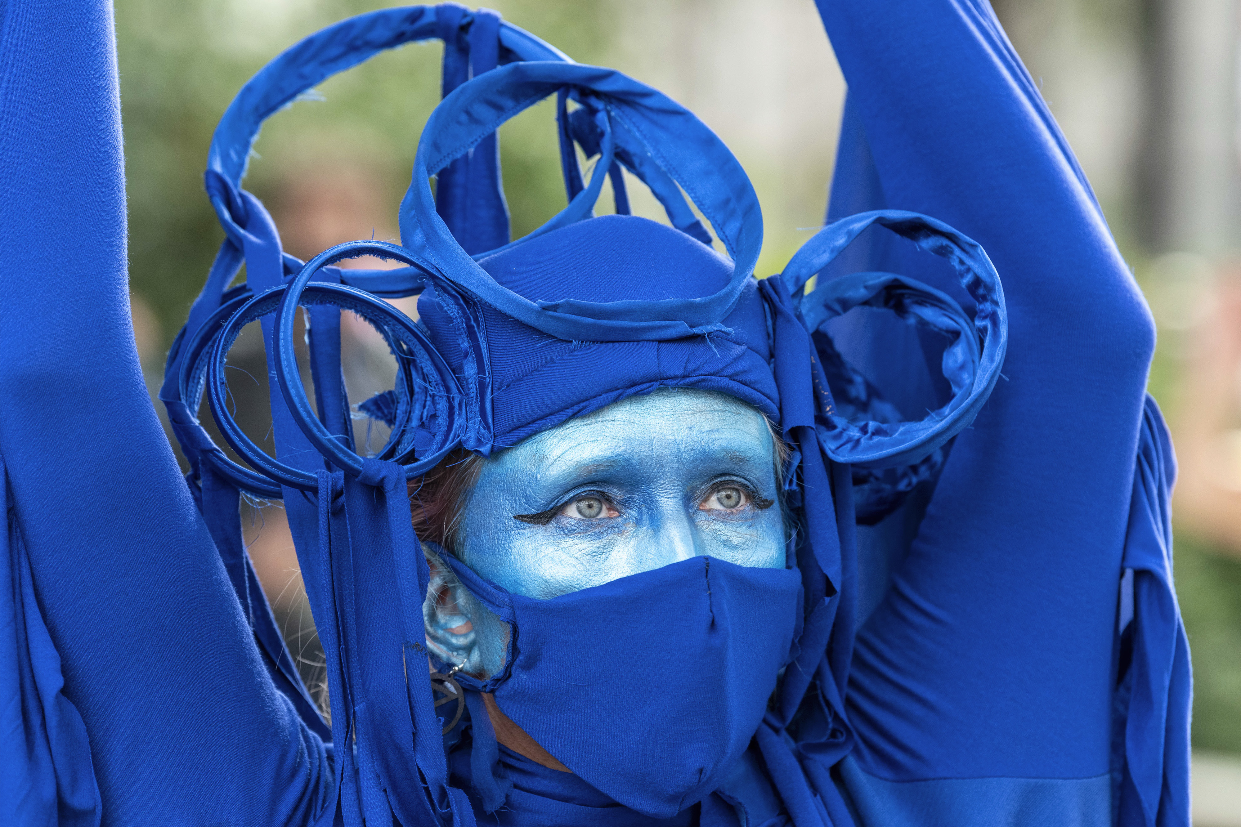 A protester wears a blue outfit to represent the ocean during the demonstration. The groups of Extinction Rebellion Marine, Ocean Rebellion, Sea Life Extinction and Animal Rebellion marched in London in a �socially distanced grief march� to demand protection for the oceans and in protest against global governmental inaction to save the seas due to climate breakdown and human interference, and the loss of lives, homes and livelihoods from rising sea levels. (Photo by Dave Rushen / SOPA Images/Sipa USA)