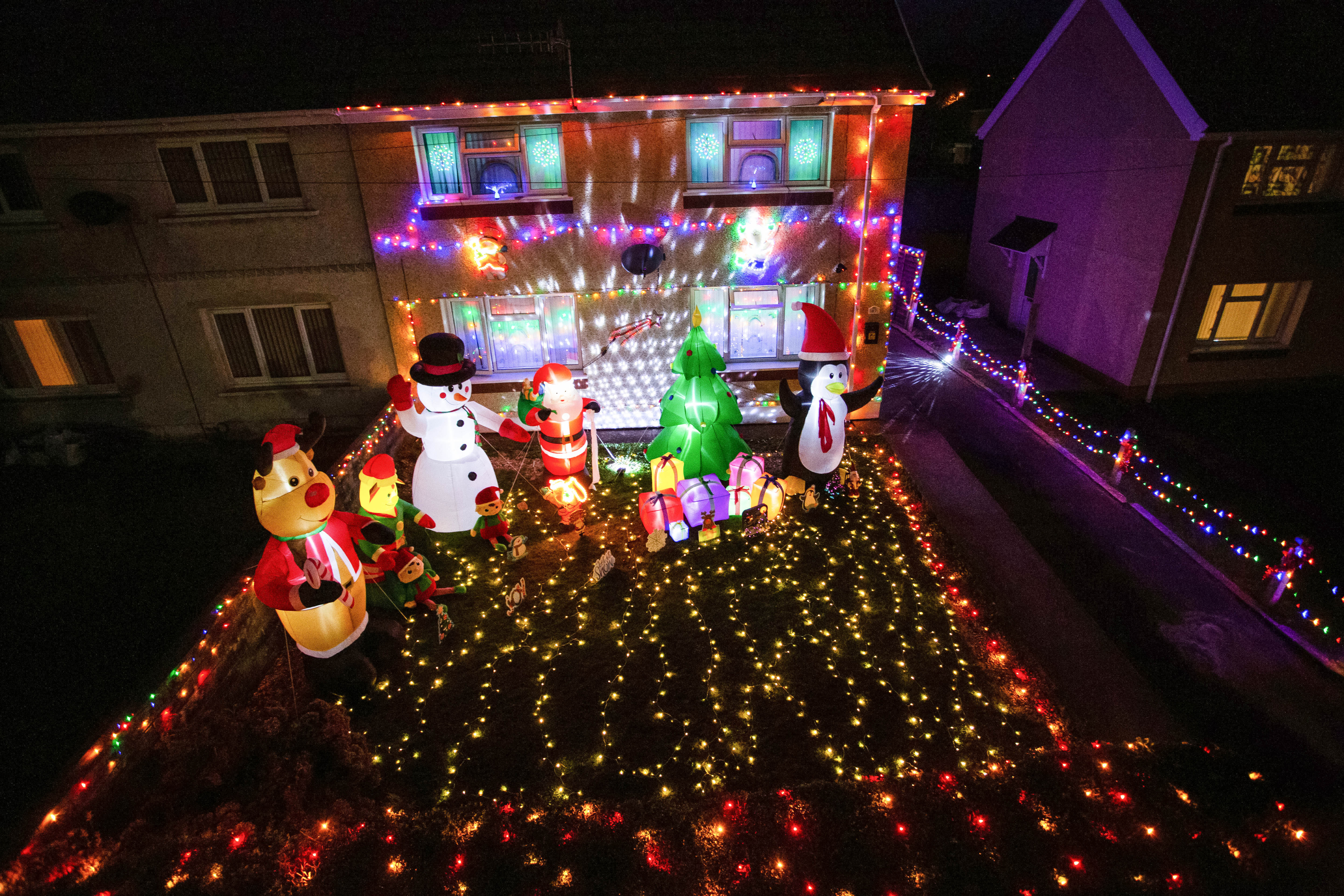 A mum has gone all out to cheer up her kids and neighbours by putting up her CHRISTMAS decorations three months early - including 3,000 outdoor lights. Caroline Gabe, 46, has been shielding with her children since March - and said putting up her tree and decorations in September was a much-needed boost. She has spent the year buying outdoor lights and installations - from as far away as America - and put them all up last week, on a whim. Almost all of them are outside - including 3,000 fairy lights, sparkling snow, an 8ft inflatable snowman, as well as Santa and his reindeer.