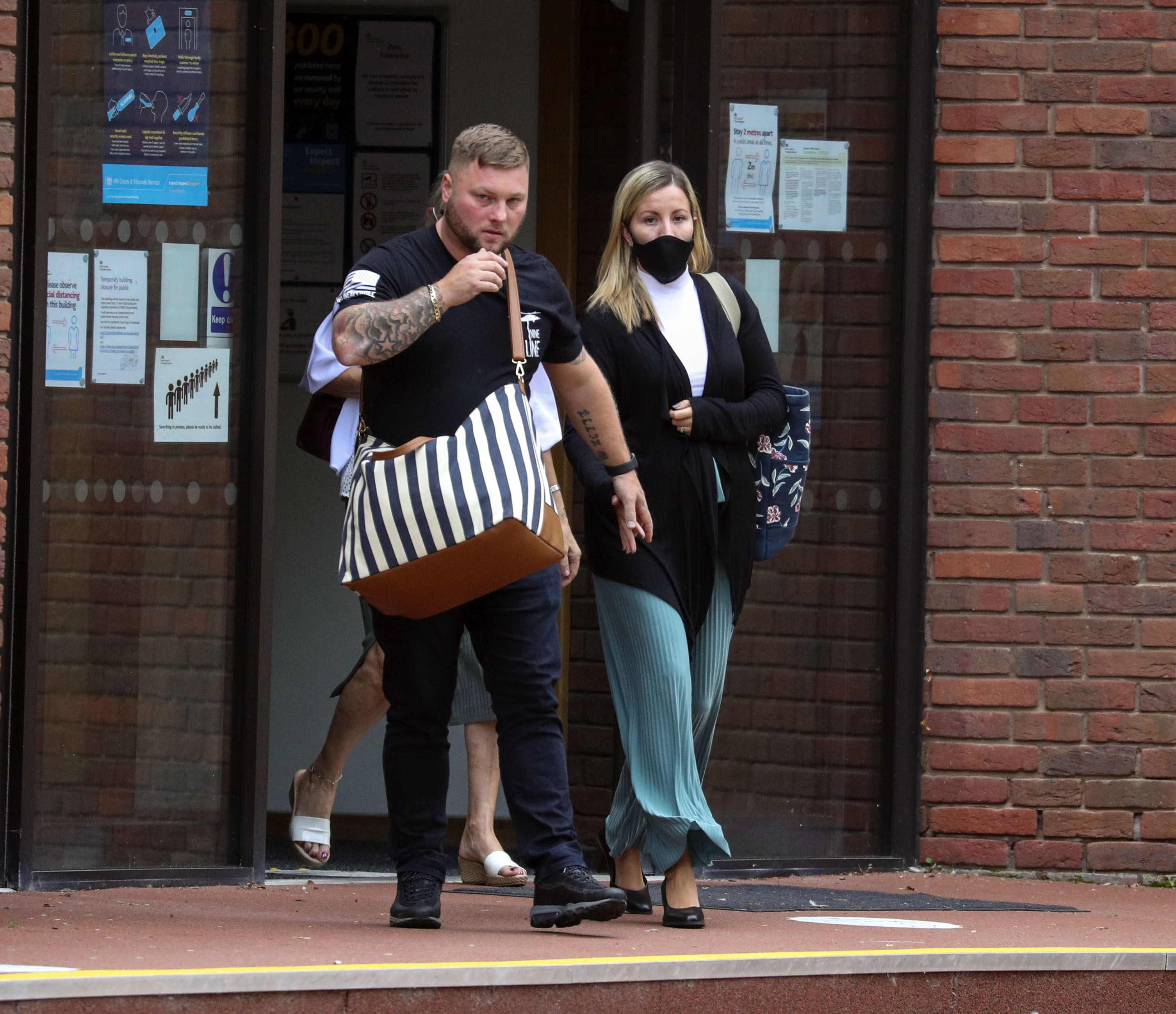 Teacher Kandice Barber, 35, leaves Aylesbury Crown Court, Buckinghamshire, with her husband Daniel, after being found guilty of two sex offence charges related to sending topless Snapchat pictures to a 15-year-old student. The jury were unable to reach verdicts on three more serious charges of causing or inciting a child aged under 16 to engage in a sexual act.