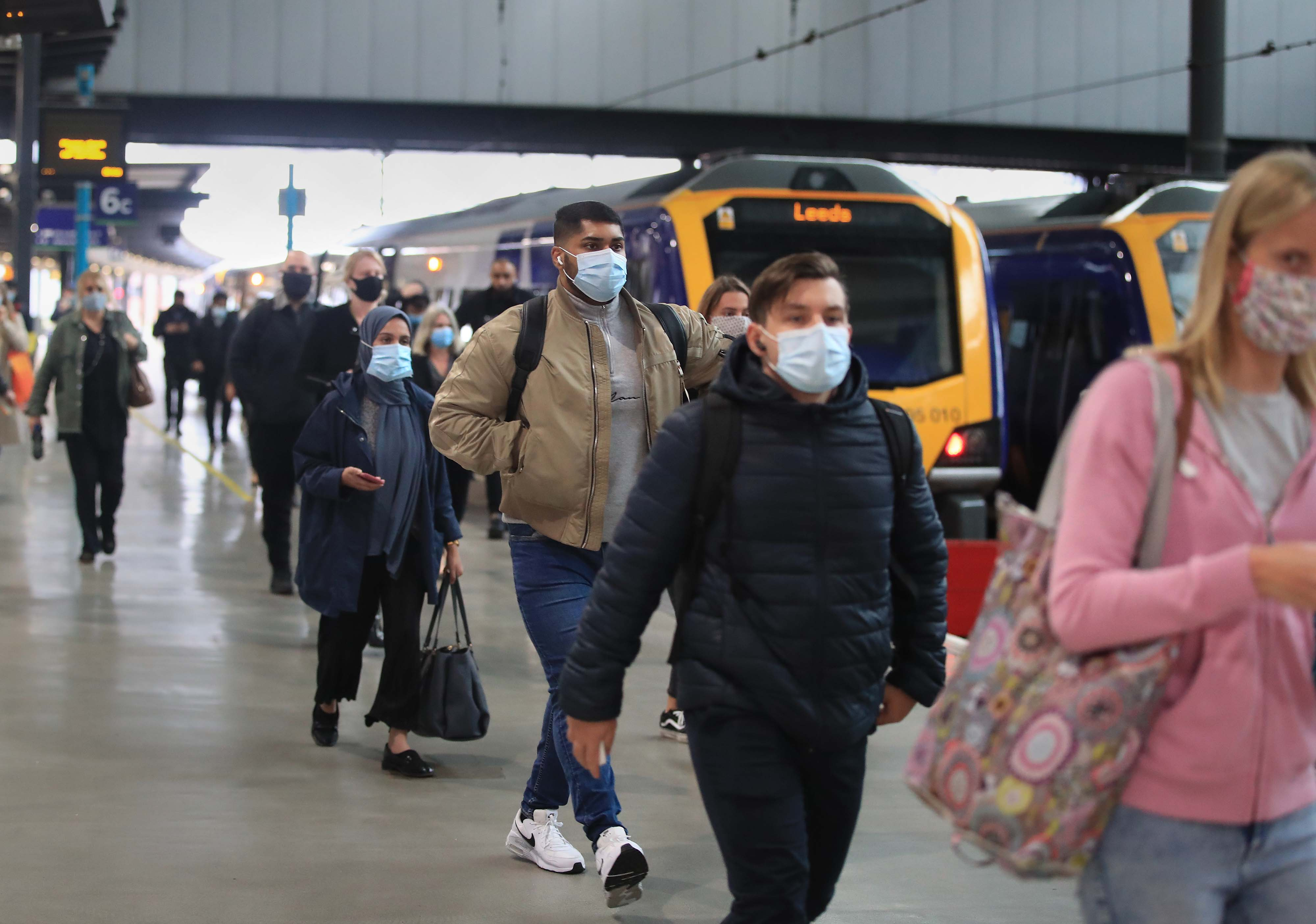 Commuters arriving at Leeds railway station. Train services will be ramped up from today as schools in England and Wales reopen and workers are encouraged to return to offices. (Photo by Danny Lawson/PA Images via Getty Images)