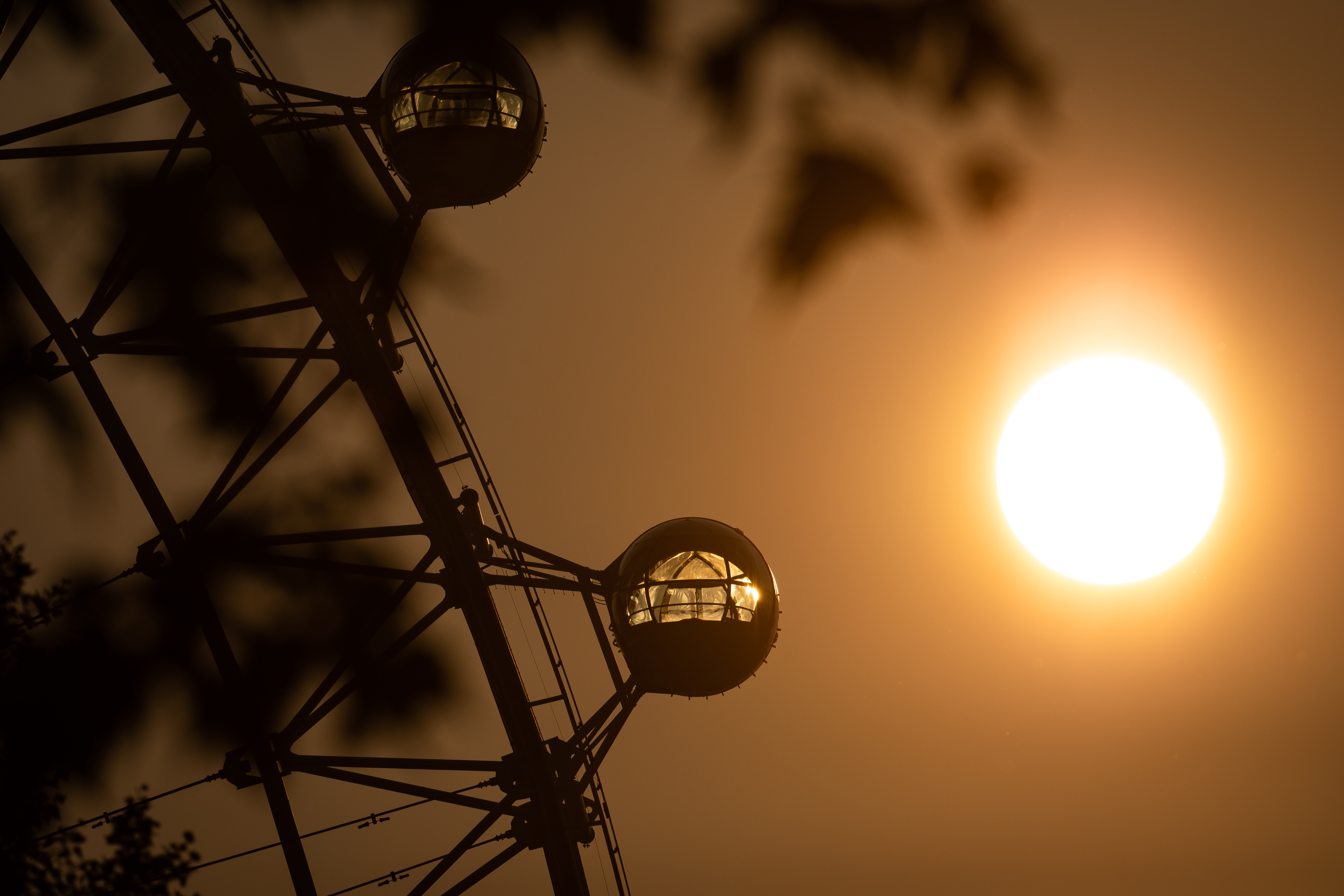 The sun rises behind the London Eye ferris wheel, London, at the start of a week in which the UK is expected to bask in temperatures of more than 30C.