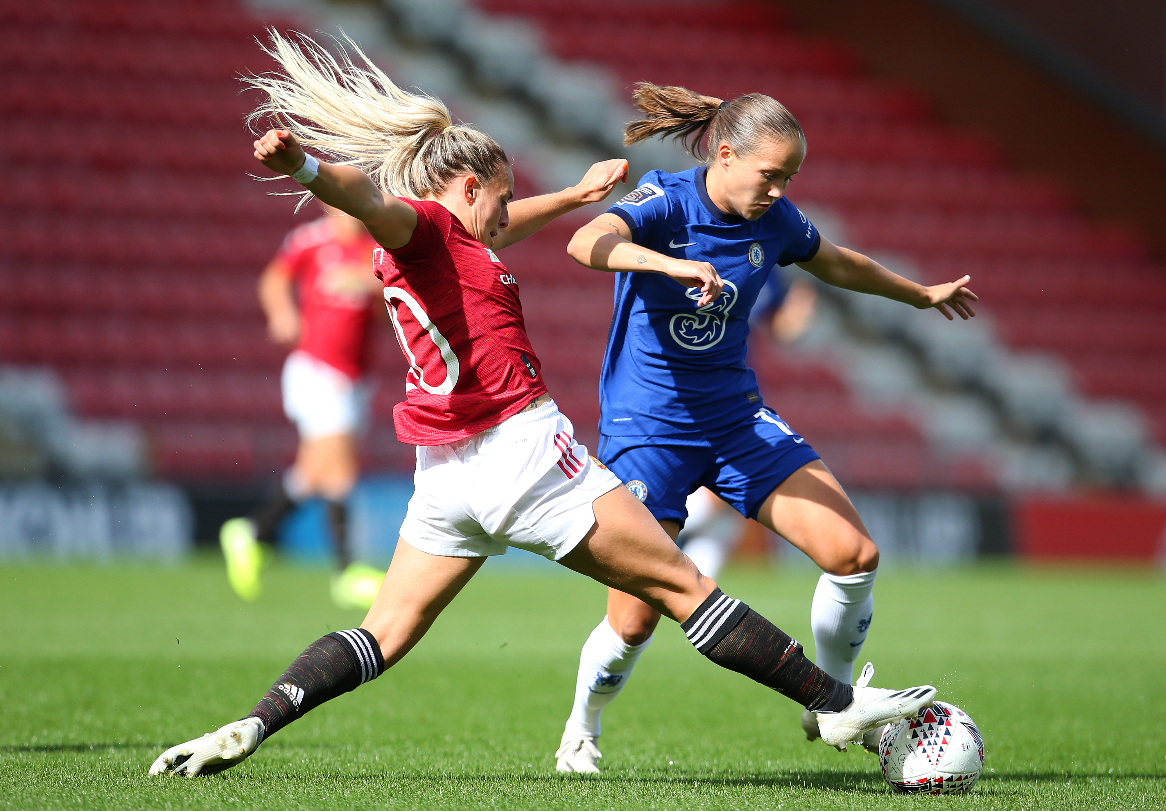 LEIGH, ENGLAND - SEPTEMBER 06:  Kirsty Smith of Manchester United Women tackles Guro Reiten of Chelsea Women during the Barclays FA Women's Super League at Leigh Sports Village on September 06, 2020 in Leigh, England. (Photo by James Gill - Danehouse/Getty Images)