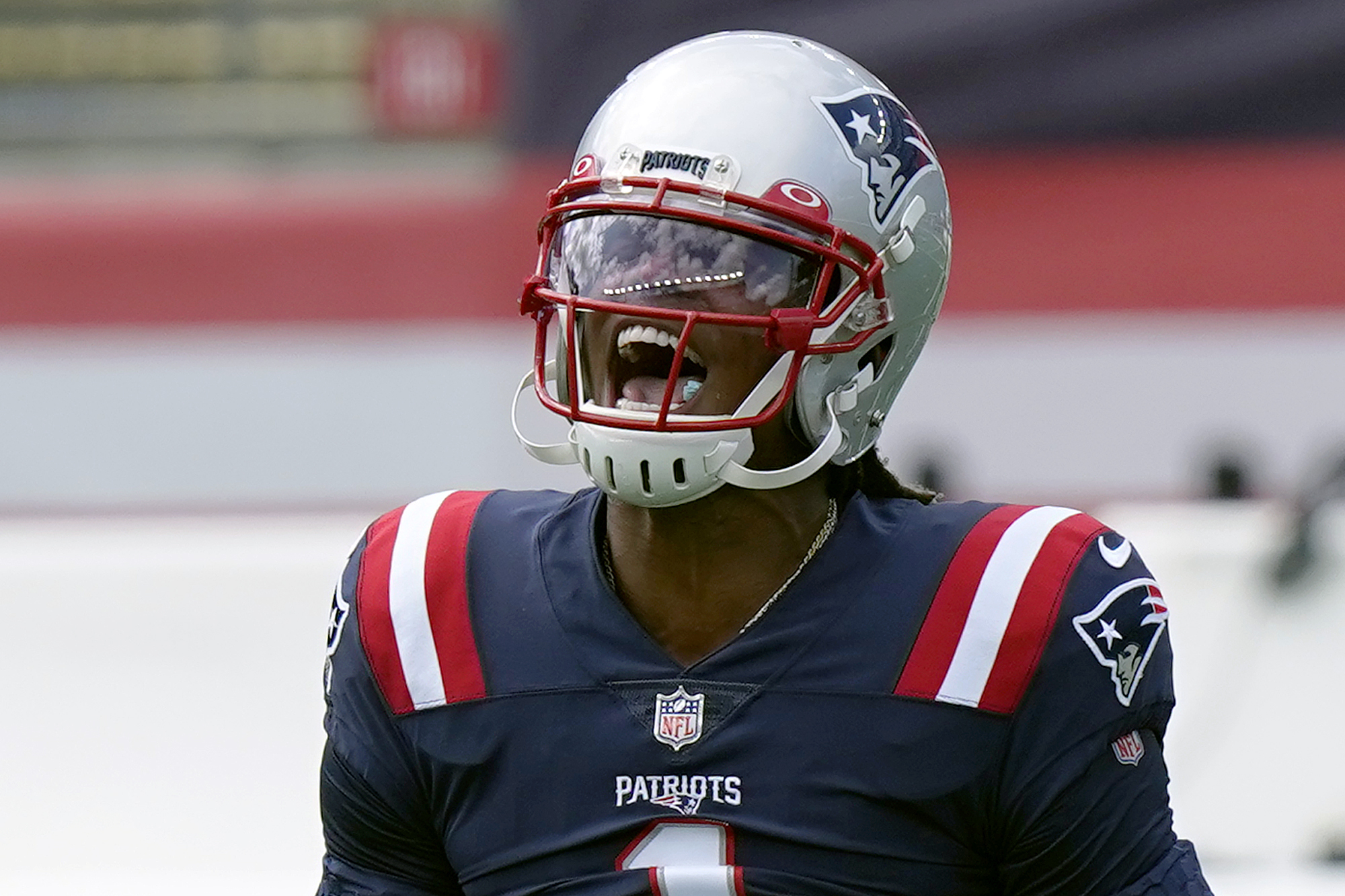 New England Patriots quarterback Cam Newton shouts as he warms up before an NFL football game against the Miami Dolphins, Sunday, Sept. 13, 2020, in Foxborough, Mass. (AP Photo/Steven Senne)