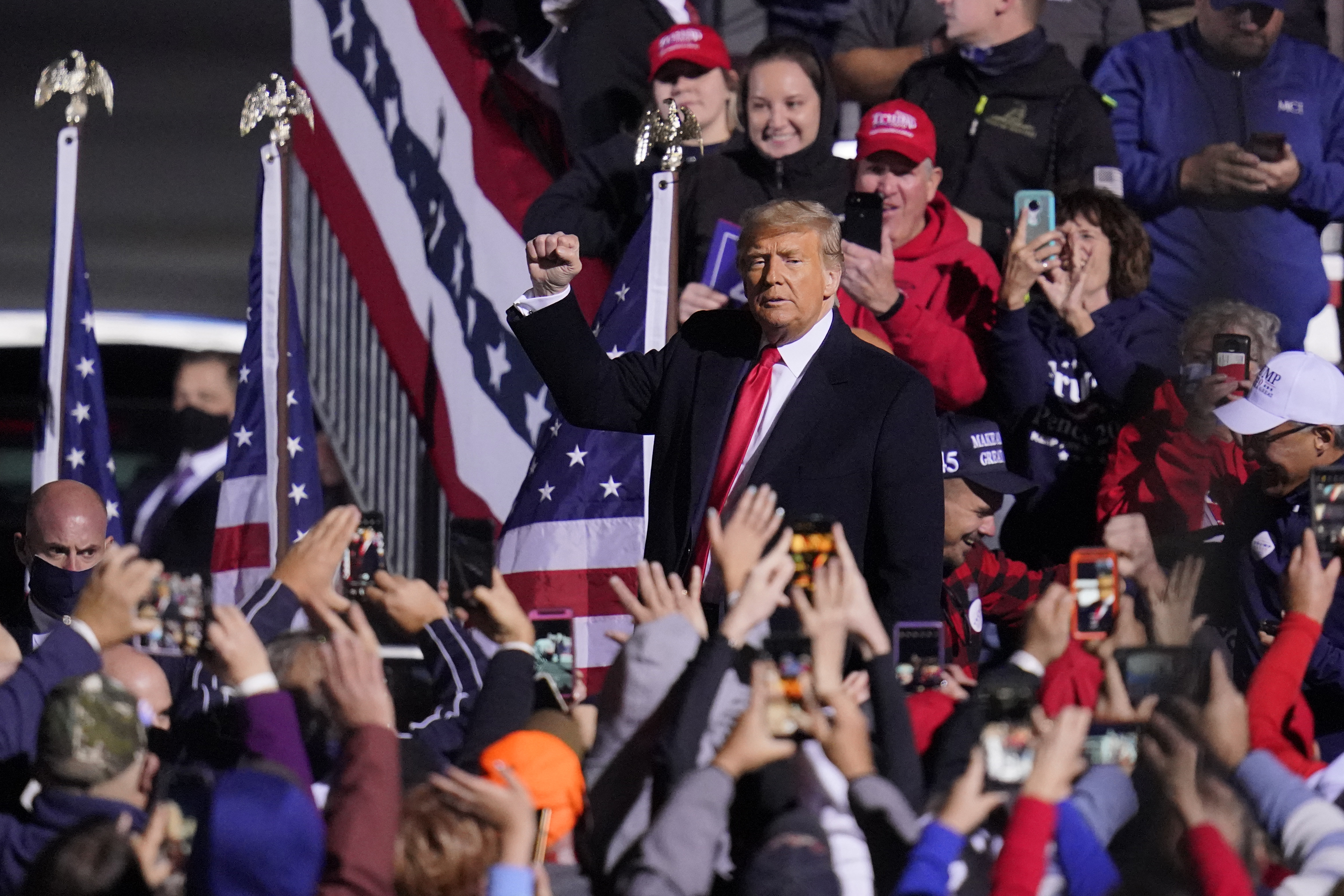 Supporters cheer as President Donald Trump departs a campaign rally at John P. Murtha Johnstown-Cambria County Airport in Johnstown, Pa., Tuesday, Oct. 13, 2020. (AP Photo/Gene J. Puskar)