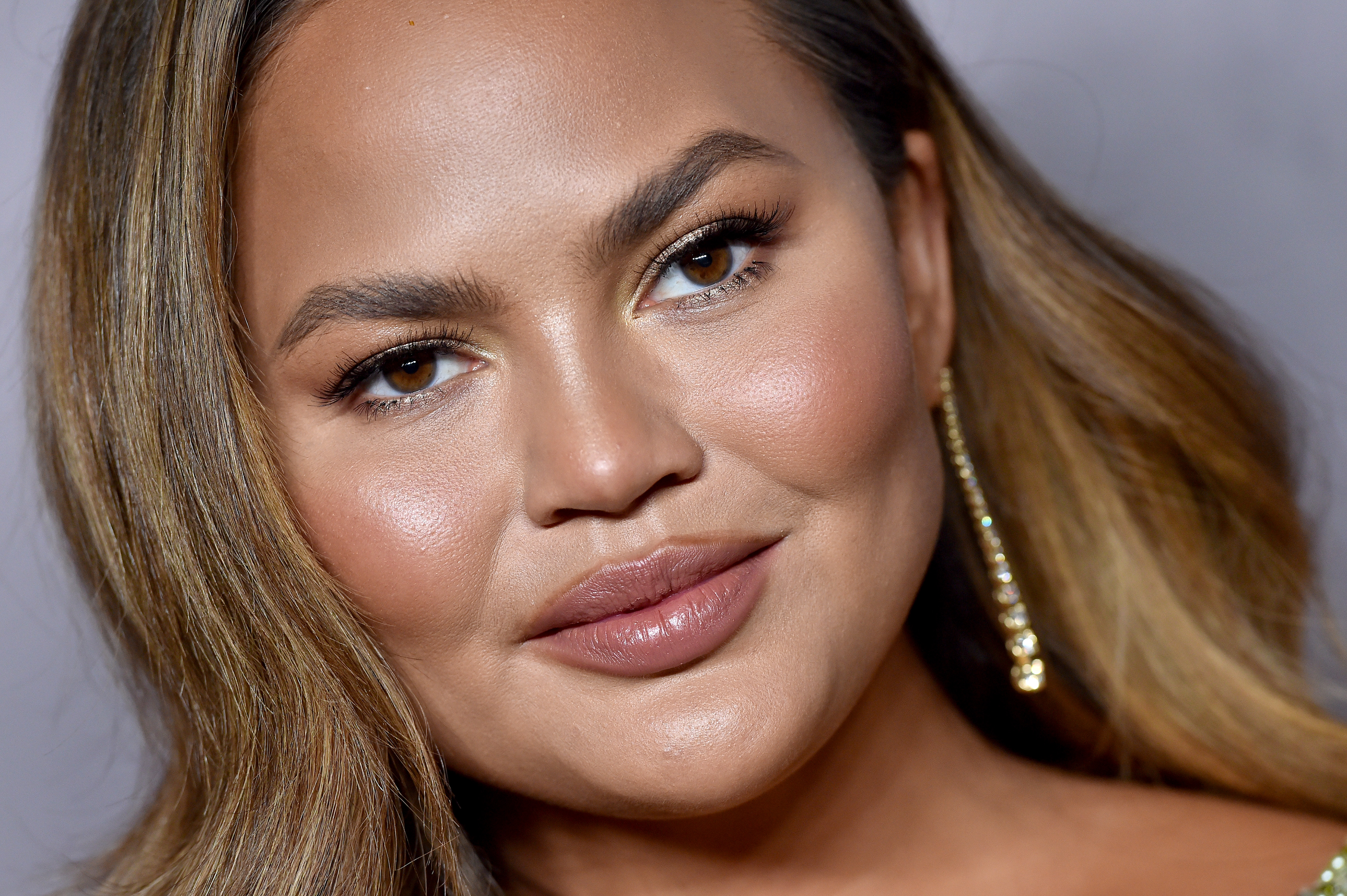 Chrissy Teigen recalls 'stress' and 'guilt' of trying to breastfeed as she calls to 'normalize formula'