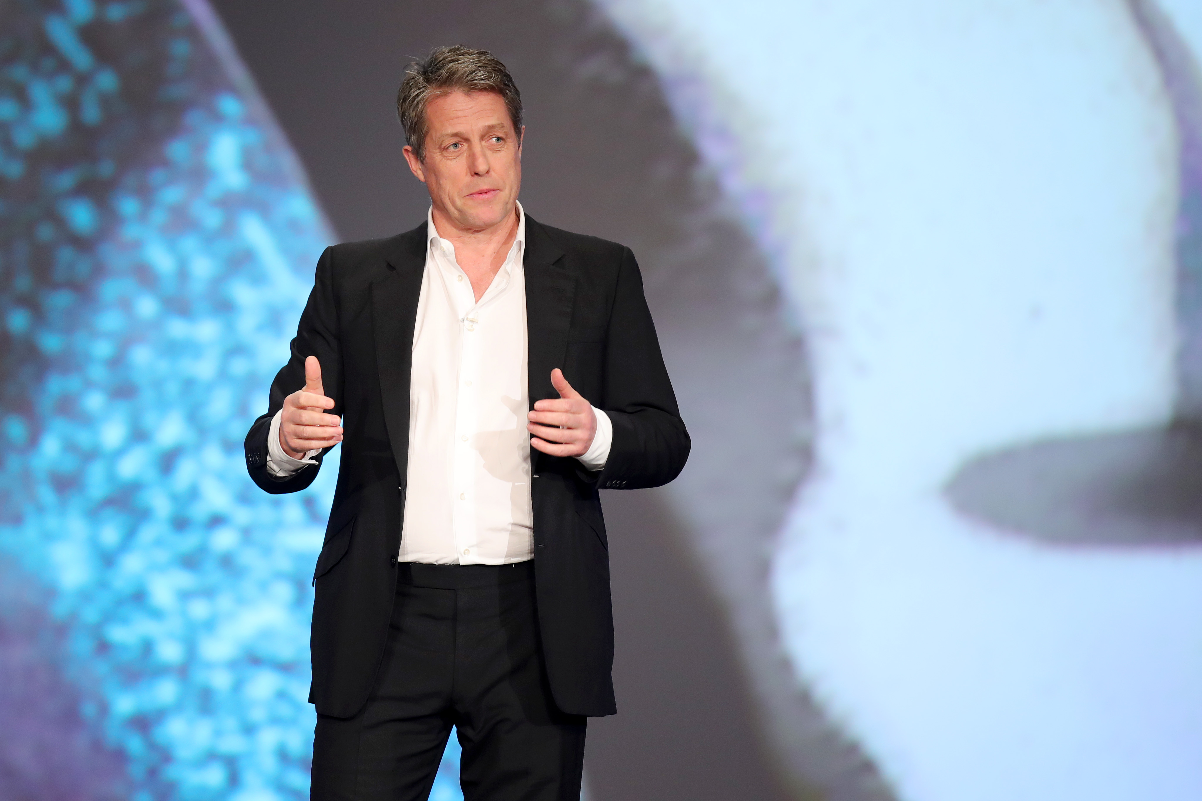 Hugh Grant has a surprising theory about George Clooney (Photo by Andreas Rentz/Getty Images for Laureus)