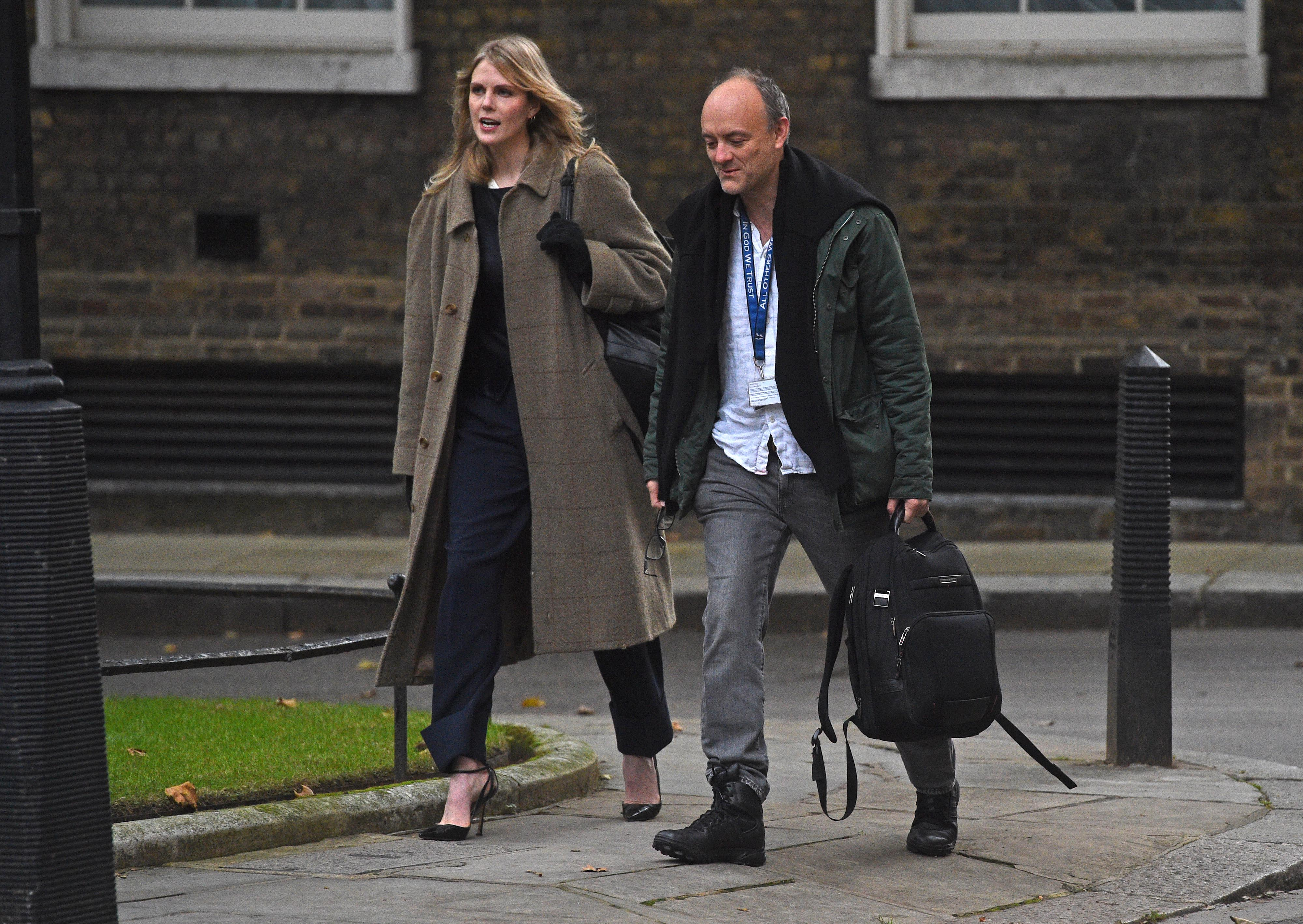 Senior aide to the Prime Minister Dominic Cummings and UK Government Adviser Cleo Watson arrive in Downing Street London, ahead of a meeting of the Government's emergency committee Cobra to discuss areas suffering a surge in Covid-19 and measures to combat the spread of the virus.