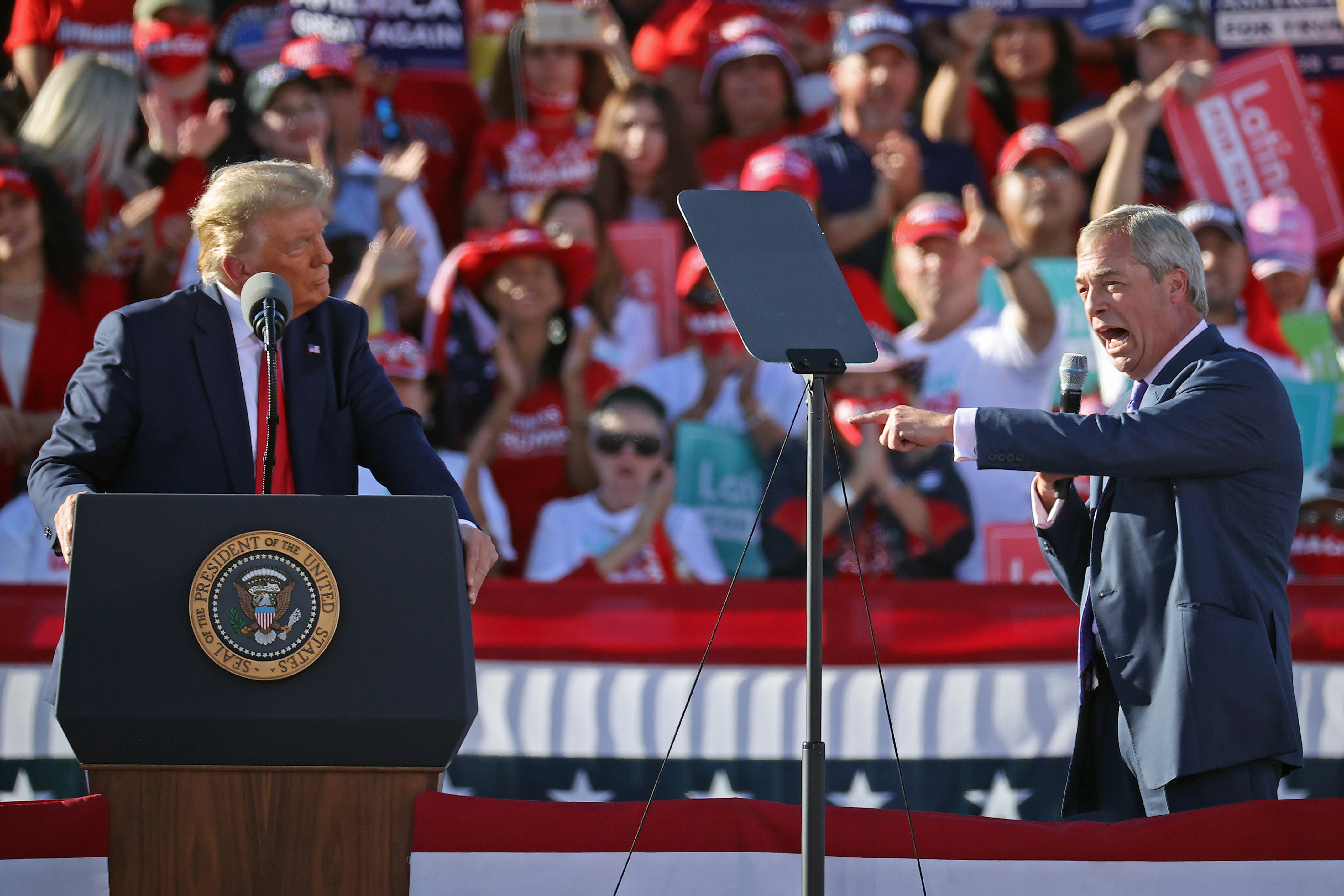 GOODYEAR, ARIZONA - OCTOBER 28: British politician Nigel Farage (R) praises U.S. President Donald Trump during a campaign rally at Phoenix Goodyear Airport October 28, 2020 in Goodyear, Arizona. With less than a week until Election Day, Trump and his opponent, Democratic presidential nominee Joe Biden, are campaigning across the country. (Photo by Chip Somodevilla/Getty Images)