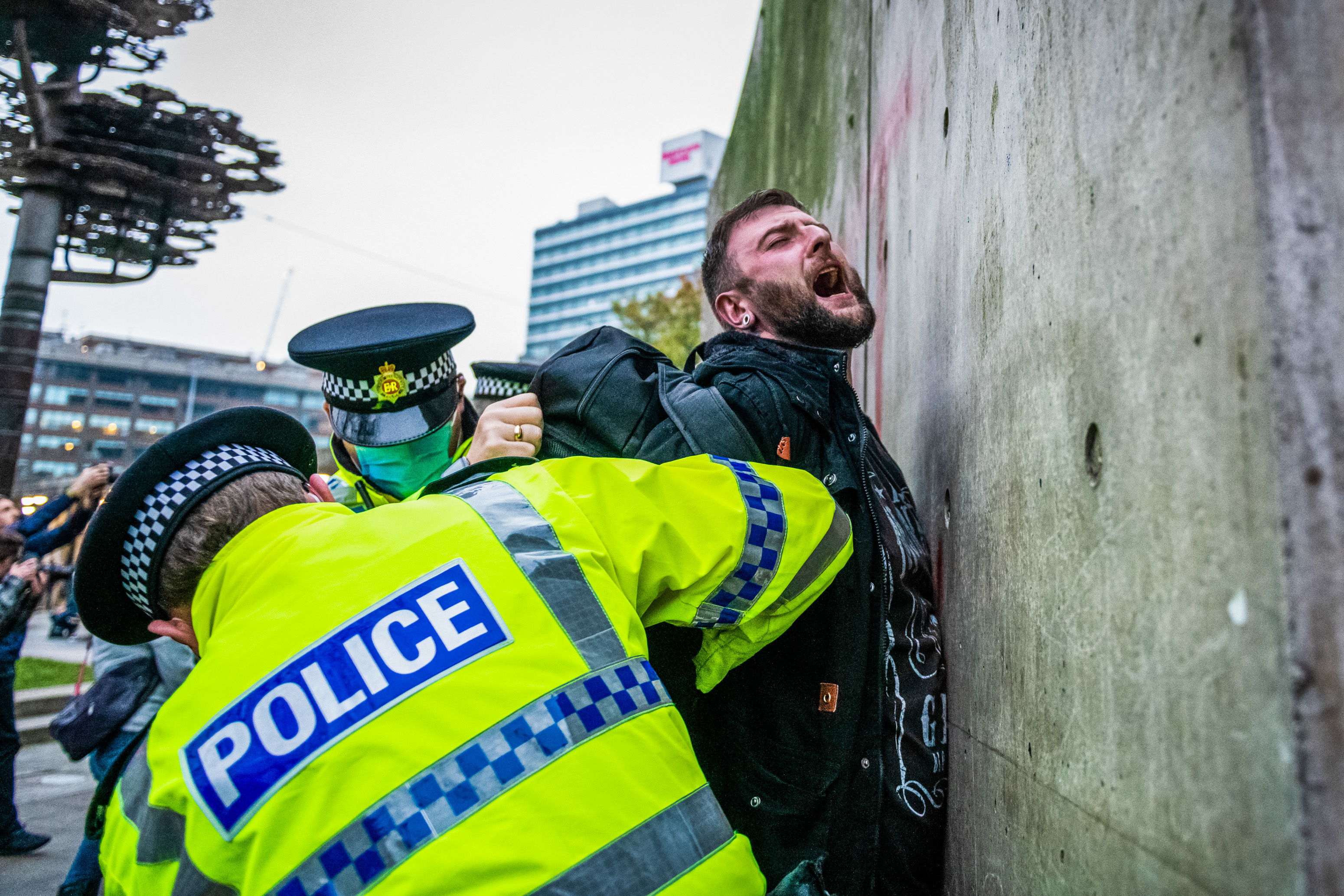 Police officers arrest a protester during the demonstration. Protests all across the country have been seen this weekend challenging the latest lockdown that was imposed on the country earlier in the week. (Photo by Kenny Brown / SOPA Images/Sipa USA)