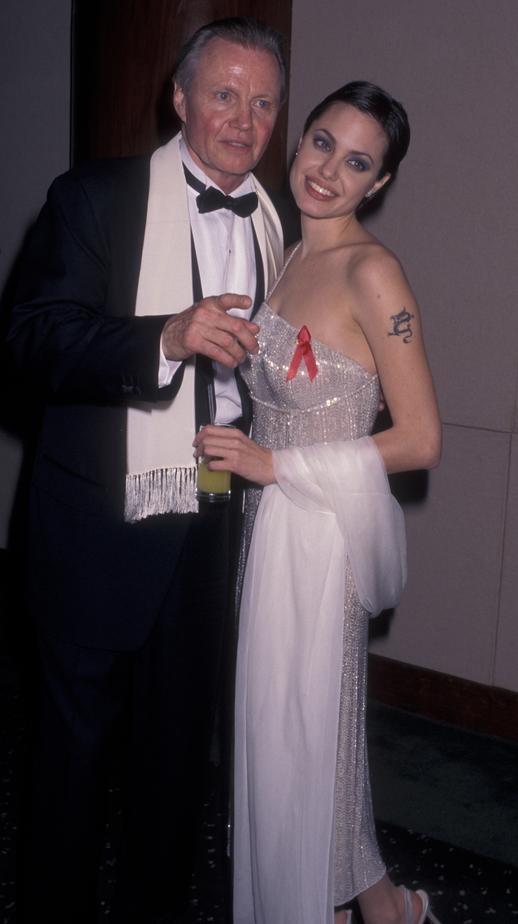 Jon Voight and Angelina Jolie attend 55th Annual Golden Globe Awards on January 18, 1998 at the Beverly Hilton Hotel in Beverly Hills, California. (Photo by Ron Galella, Ltd./Ron Galella Collection via Getty Images)