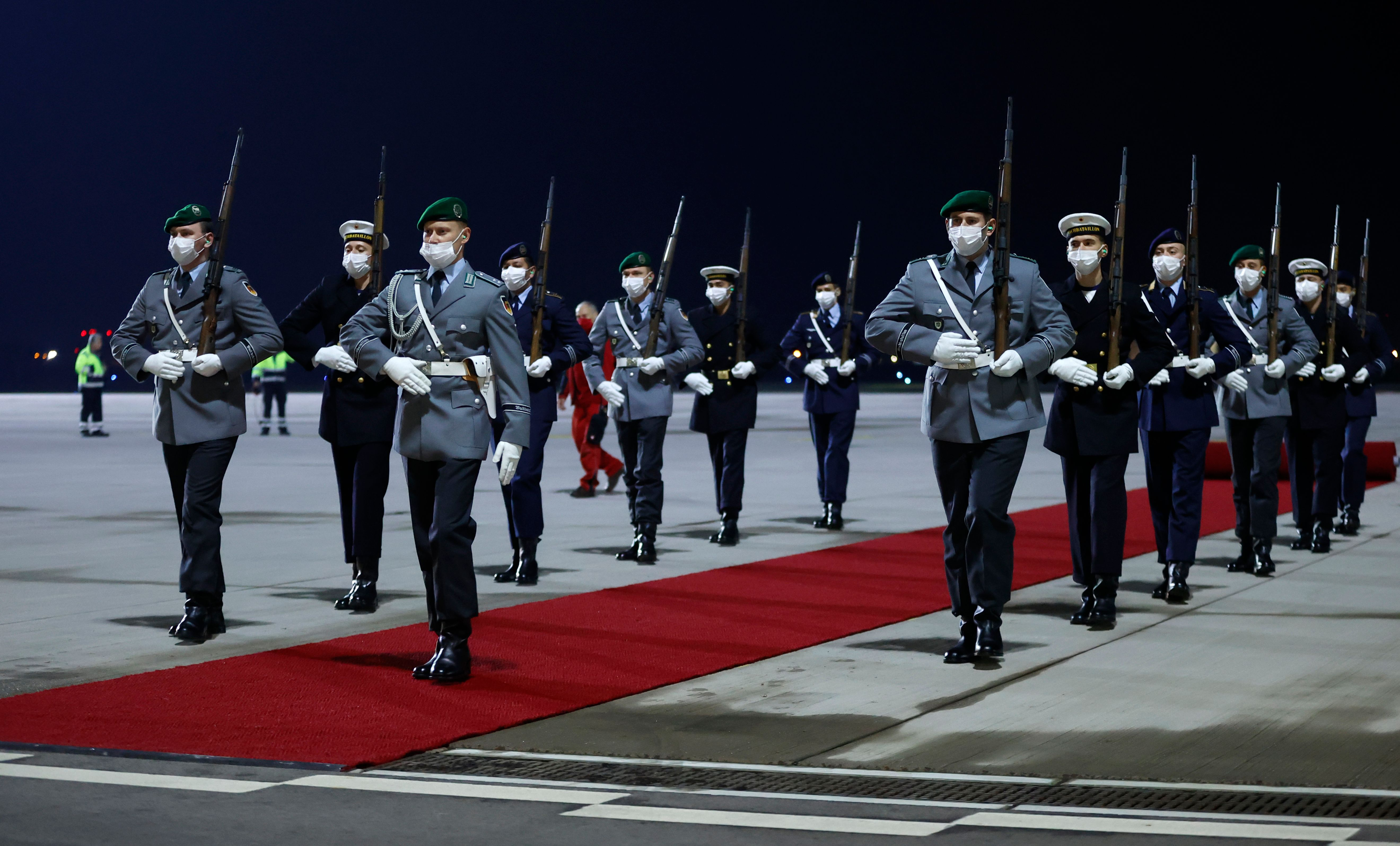 Soldiers of an honor guard prepare to welcome Britain's Prince Charles, Prince of Wales and Camilla, Duchess of Cornwall, expected to arrive at Berlin Brandenburg Airport (BER) in Schoenefeld on November 14, 2020. - The royals will visit the German capital for a wreath laying ceremony on national Memorial Day at Neue Wache and a visit to parliament on November 15, 2020. (Photo by Odd ANDERSEN / various sources / AFP) (Photo by ODD ANDERSEN/POOL/AFP via Getty Images)