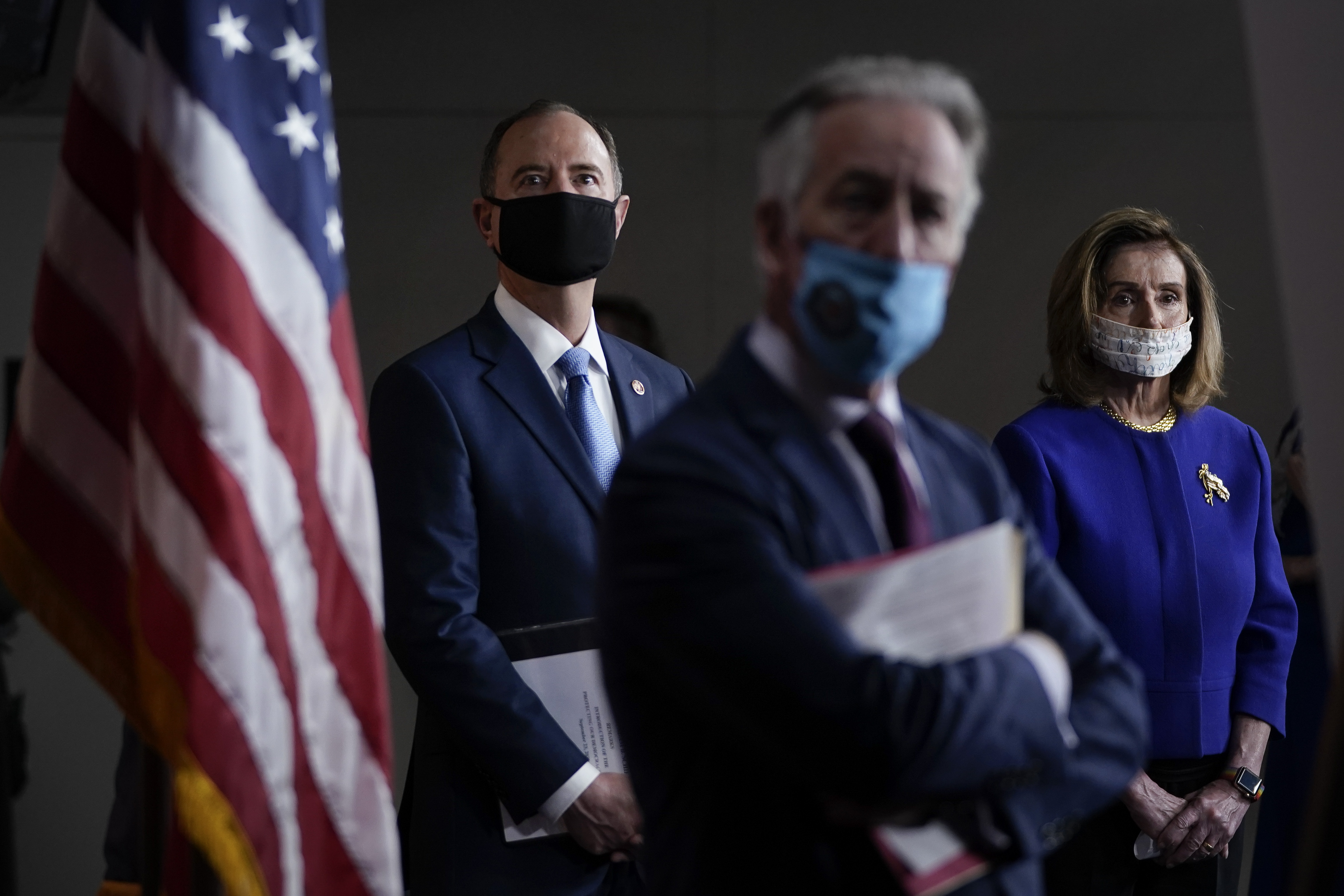 WASHINGTON, DC - SEPTEMBER 23: (L-R) Rep. Adam Schiff (D-CA), Rep. Richard Neal (D-MA) and Speaker of the House Nancy Pelosi (D-CA) attend a news conference at the U.S. Capitol on September 23, 2020 in Washington, DC. Pelosi and fellow House Democrats introduced a package of sweeping reforms aimed at curbing presidential abuse of power. (Photo by Drew Angerer/Getty Images)