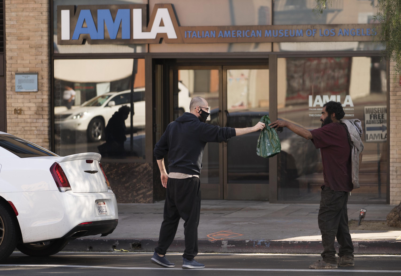 Los Angeles orders more restrictions as coronavirus surges