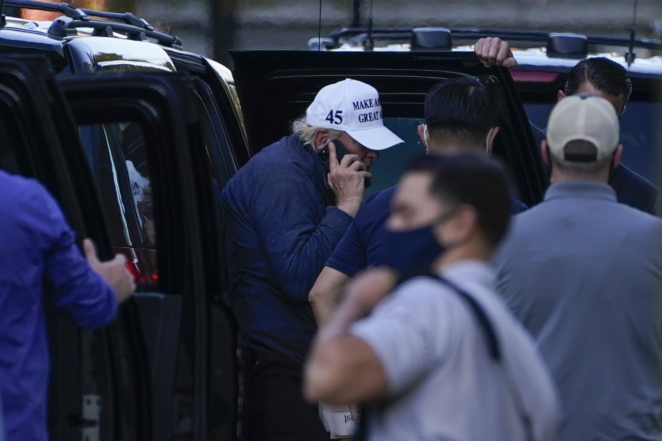 President Donald Trump talks on the phone as he arrives at the White House after golfing Saturday, Nov. 7, 2020, in Washington. (AP Photo/Evan Vucci)