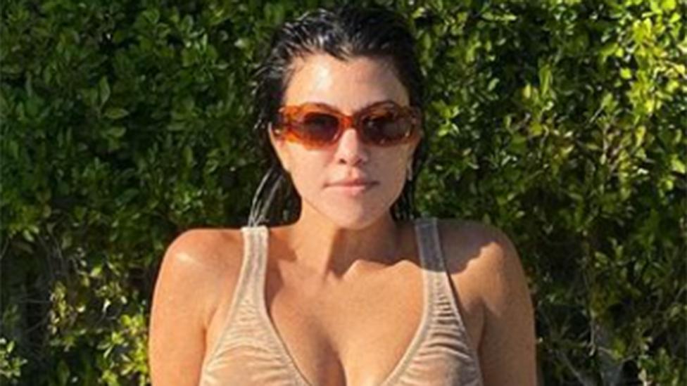 Kourtney Kardashian causes double-take in nude bikini