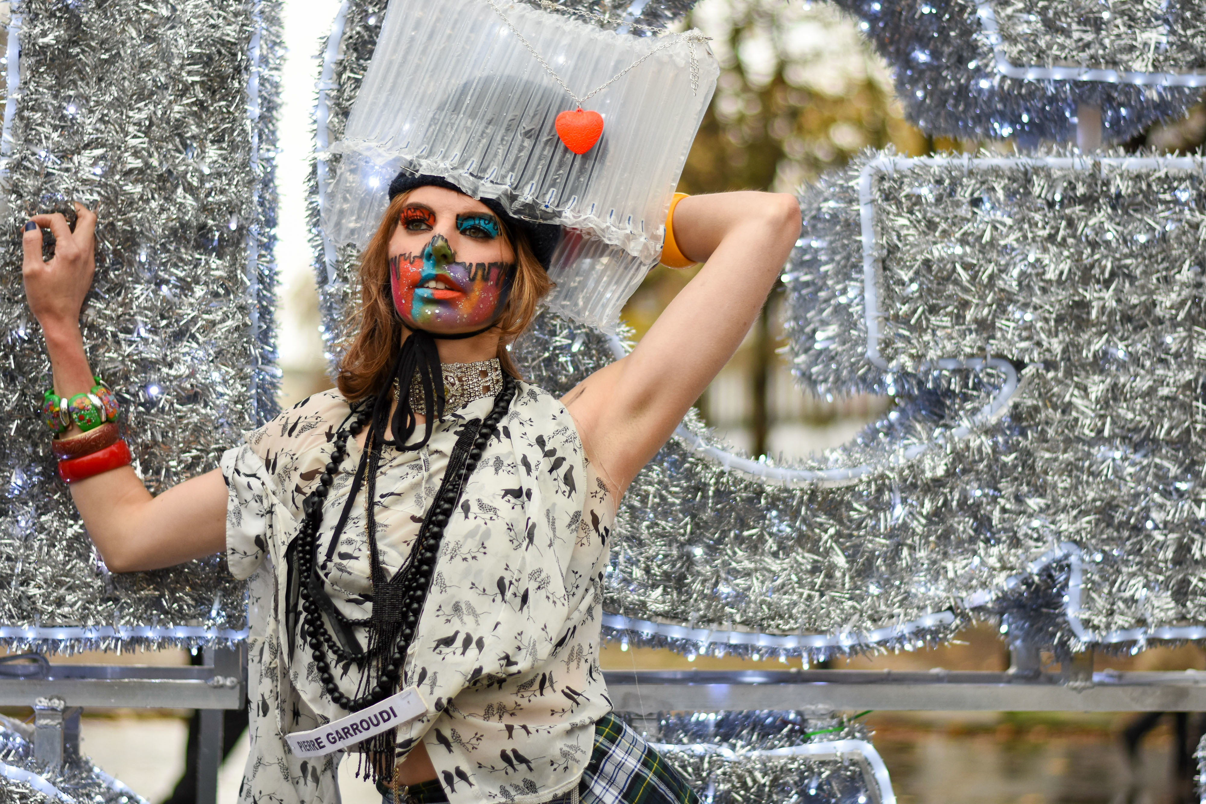 A model showcases Pierre Garroudi latest collection during the flash mob fashion show at Sloane Square. (Photo by Pietro Recchia / SOPA Images/Sipa USA)