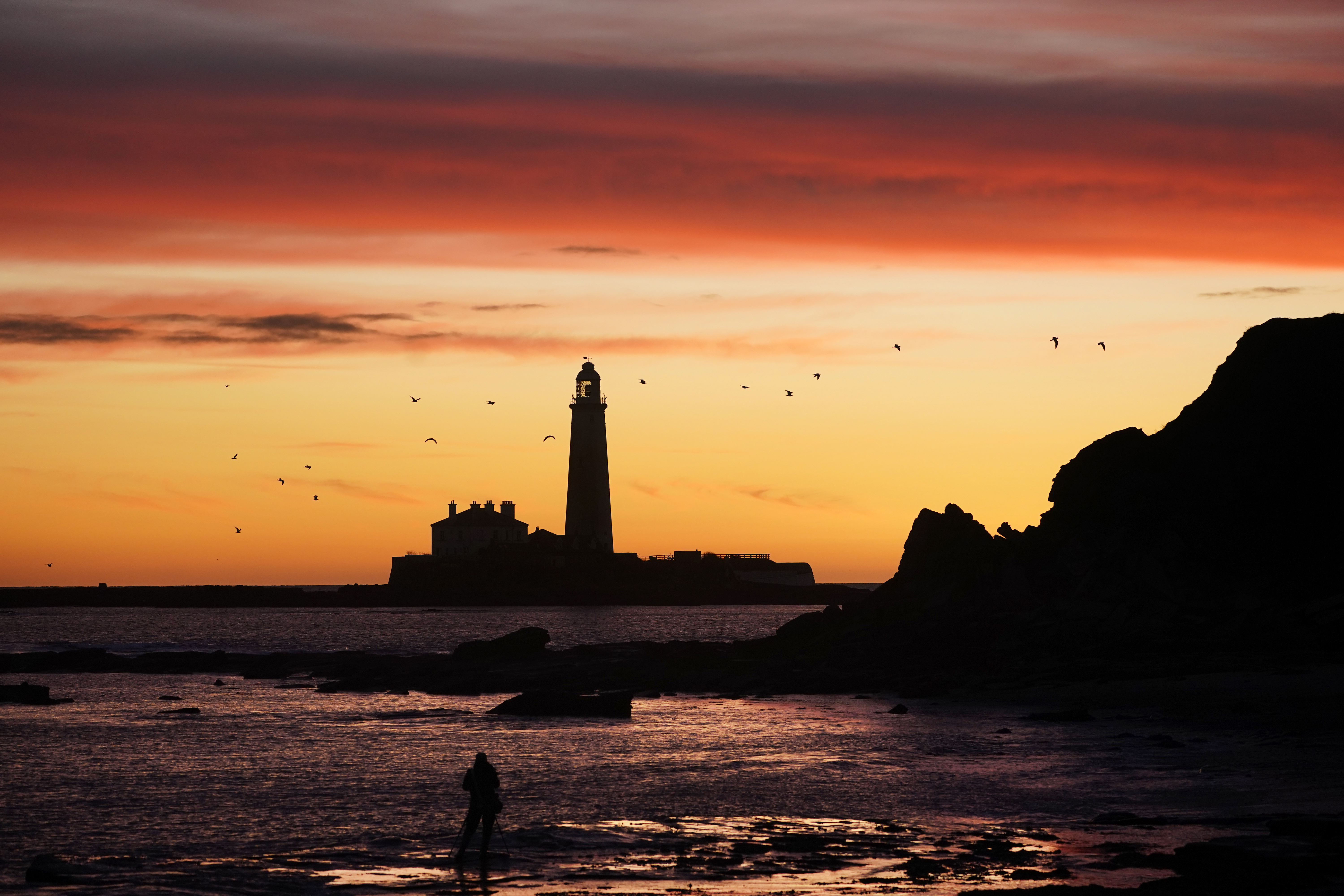 A pallet of changing colours as the sky lights up before sunrise at St Mary's Lighthouse in Whitley Bay, Tyne and Wear on the North East coast. (Photo by Owen Humphreys/PA Images via Getty Images)