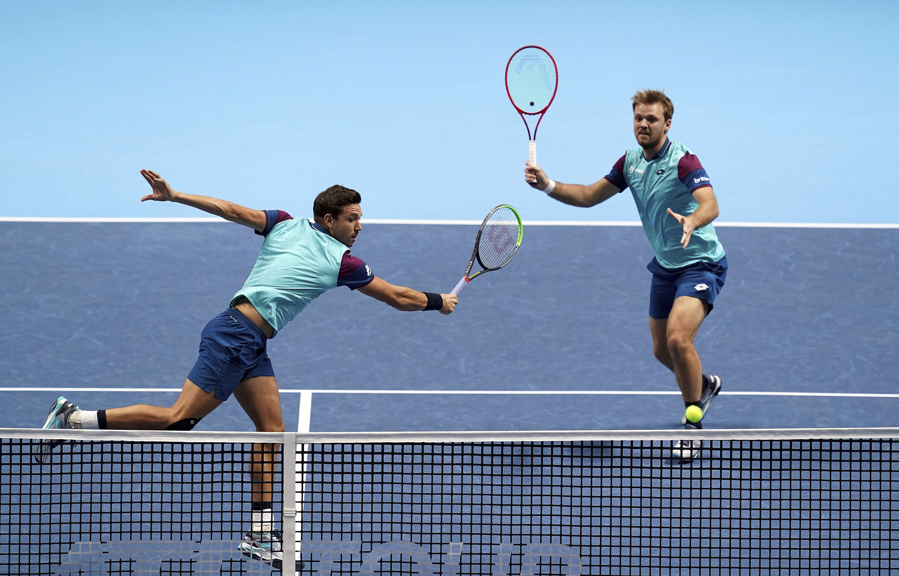 Kevin Krawietz and Andreas Mies of Germany, in action against Croatia's Nikola Mektic and Netherland's Wesley Koolhof, during their doubles match on day one of the ATP Finals tennis championship at The O2 Arena, London, Sunday Nov. 15, 2020. (John Walton/PA via AP)