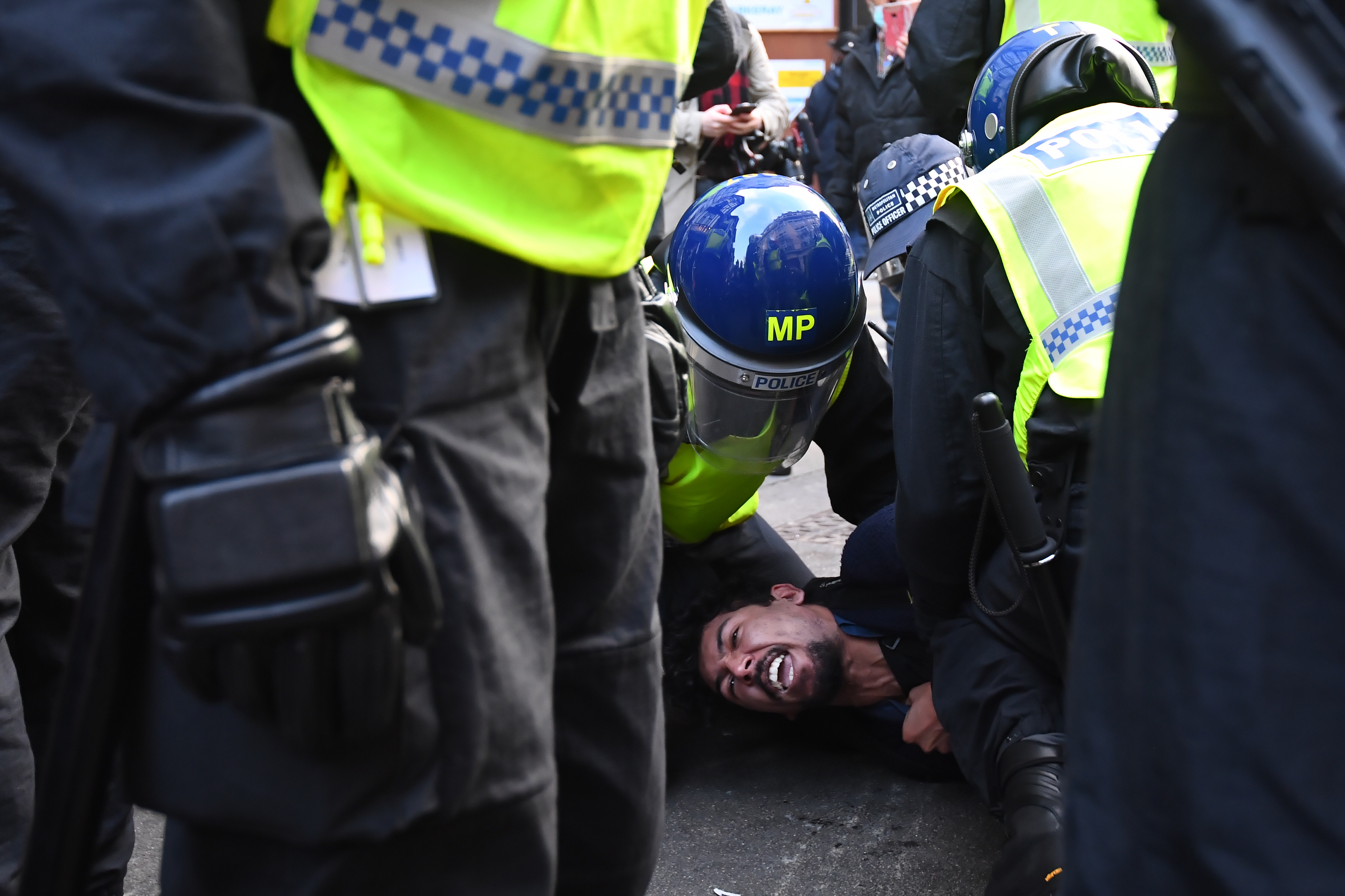 Police detain a man during an anti-lockdown protest at Oxford Circus, London. (Photo by Victoria Jones/PA Images via Getty Images)