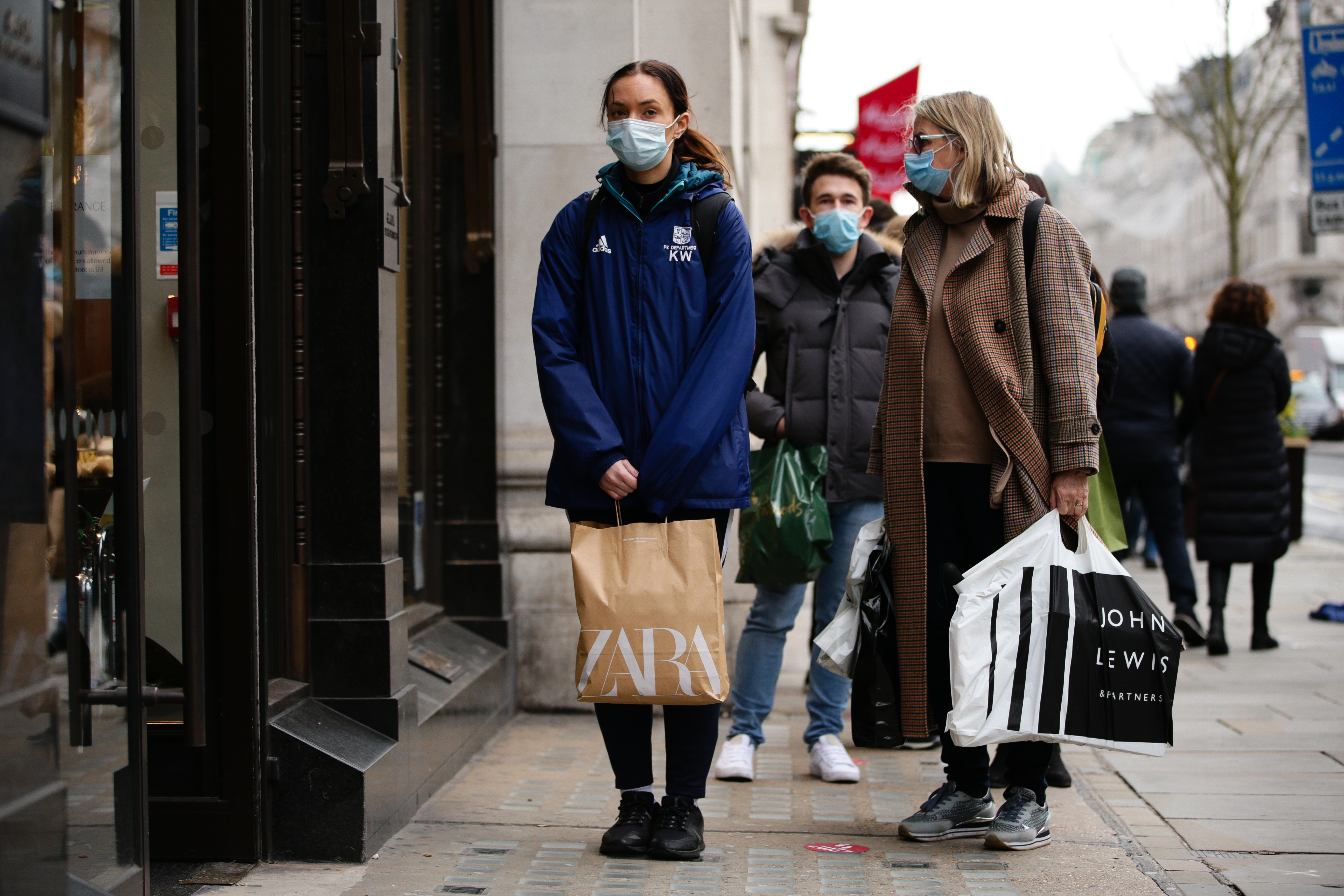 Shoppers wearing face masks queue to enter a homeware store on Regent Street in London, England, on December 4, 2020. London has returned to so-called Tier 2 or 'high alert' coronavirus restrictions since the end of the four-week, England-wide lockdown on Wednesday, meaning a reopening of non-essential shops and hospitality businesses as the festive season gets underway. Rules under all three of England's tiers have been strengthened from before the November lockdown, however, with pubs and restaurants most severely impacted. In London's West End, Oxford Street and Regent Street were both busy with Christmas shoppers this afternoon, meanwhile, with the retail sector hoping for a strong end to one of its most difficult years. (Photo by David Cliff/NurPhoto via Getty Images)