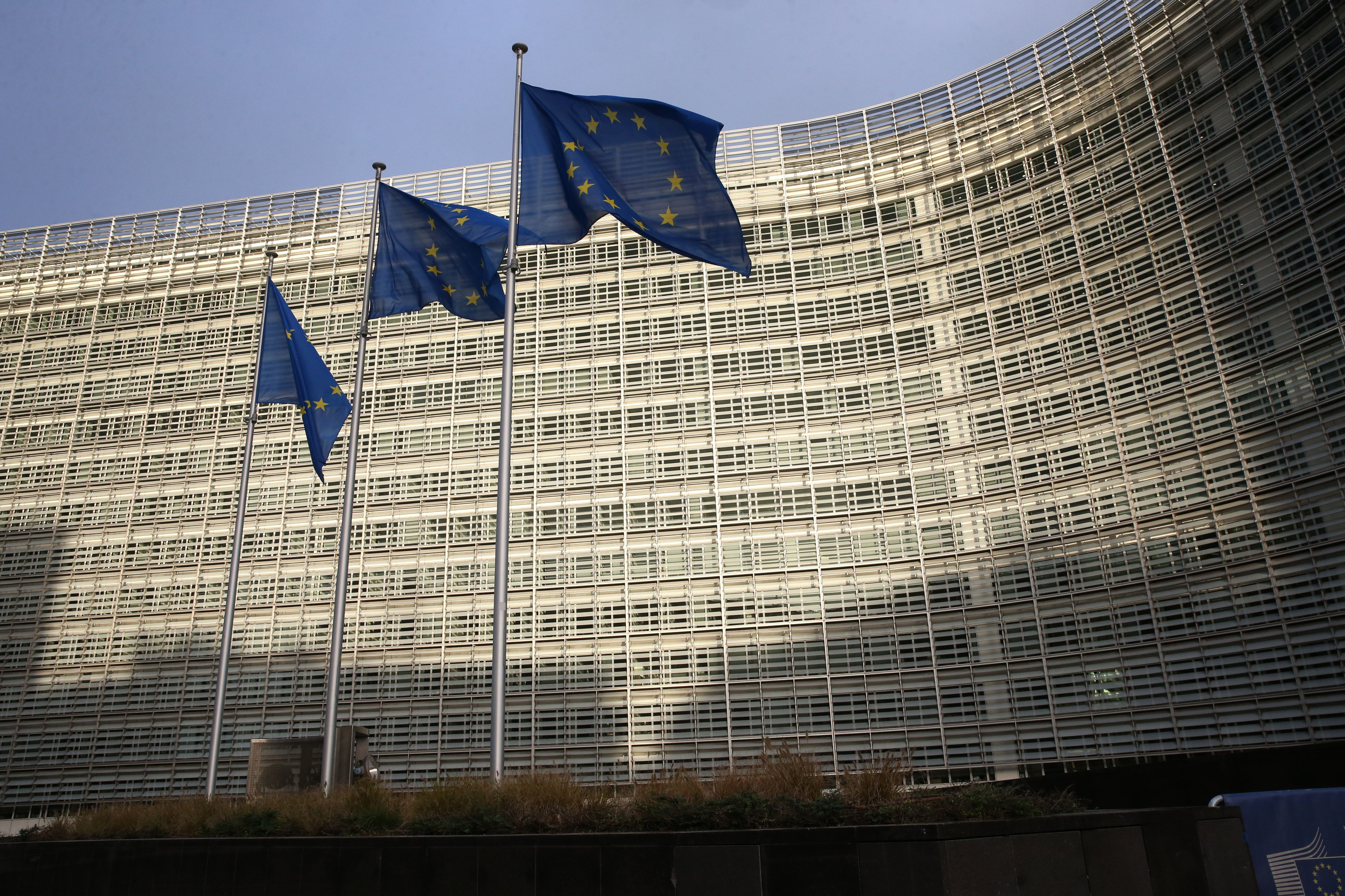 In this picture taken on December 25, 2020 flags of the European Union can be seen fluttering outside the European commission headquarters in Brussels. (Photo by François WALSCHAERTS / AFP) (Photo by FRANCOIS WALSCHAERTS/AFP via Getty Images)