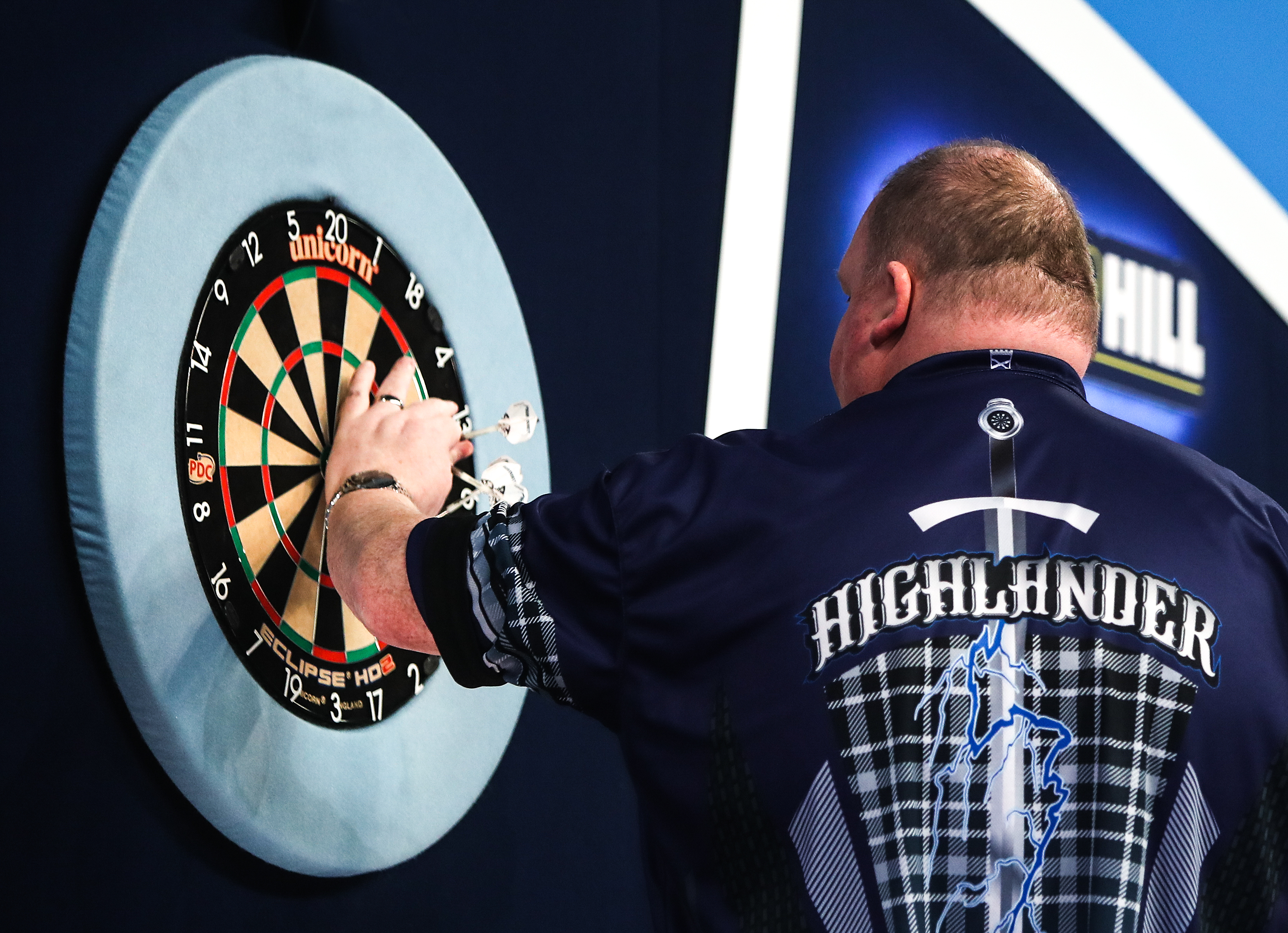 John Henderson picks his darts out of the dartboard during day six of the William Hill World Darts Championship at Alexandra Palace, London. (Photo by Kieran Cleeves/PA Images via Getty Images)